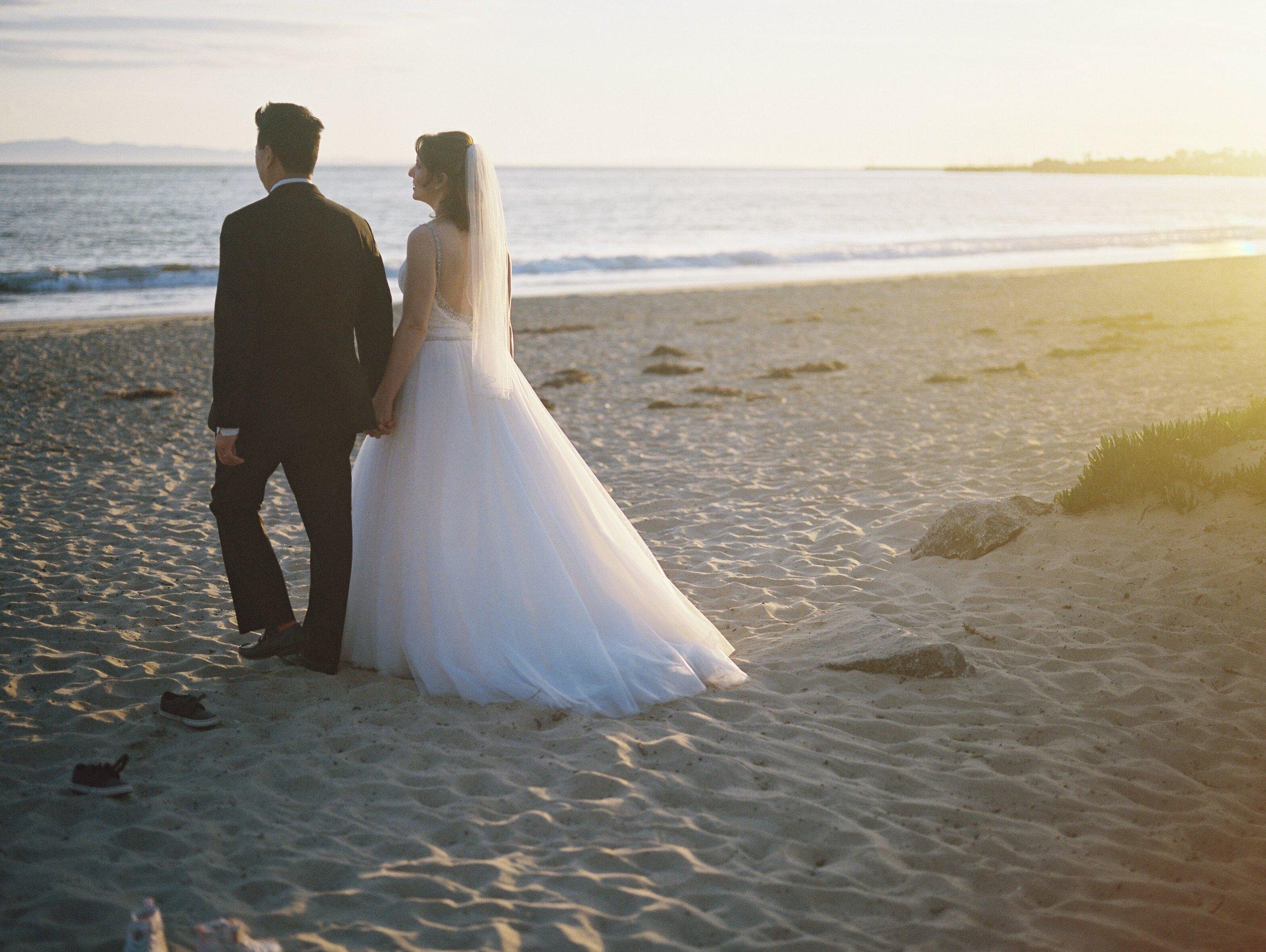 www.santabarbawedding.com | Venue: Santa Barbara Courthouse | Photography: Ryanne Bee Photography | Officiant: Santa Barbara Classic Weddings | Bride and Groom Staring at the Sea