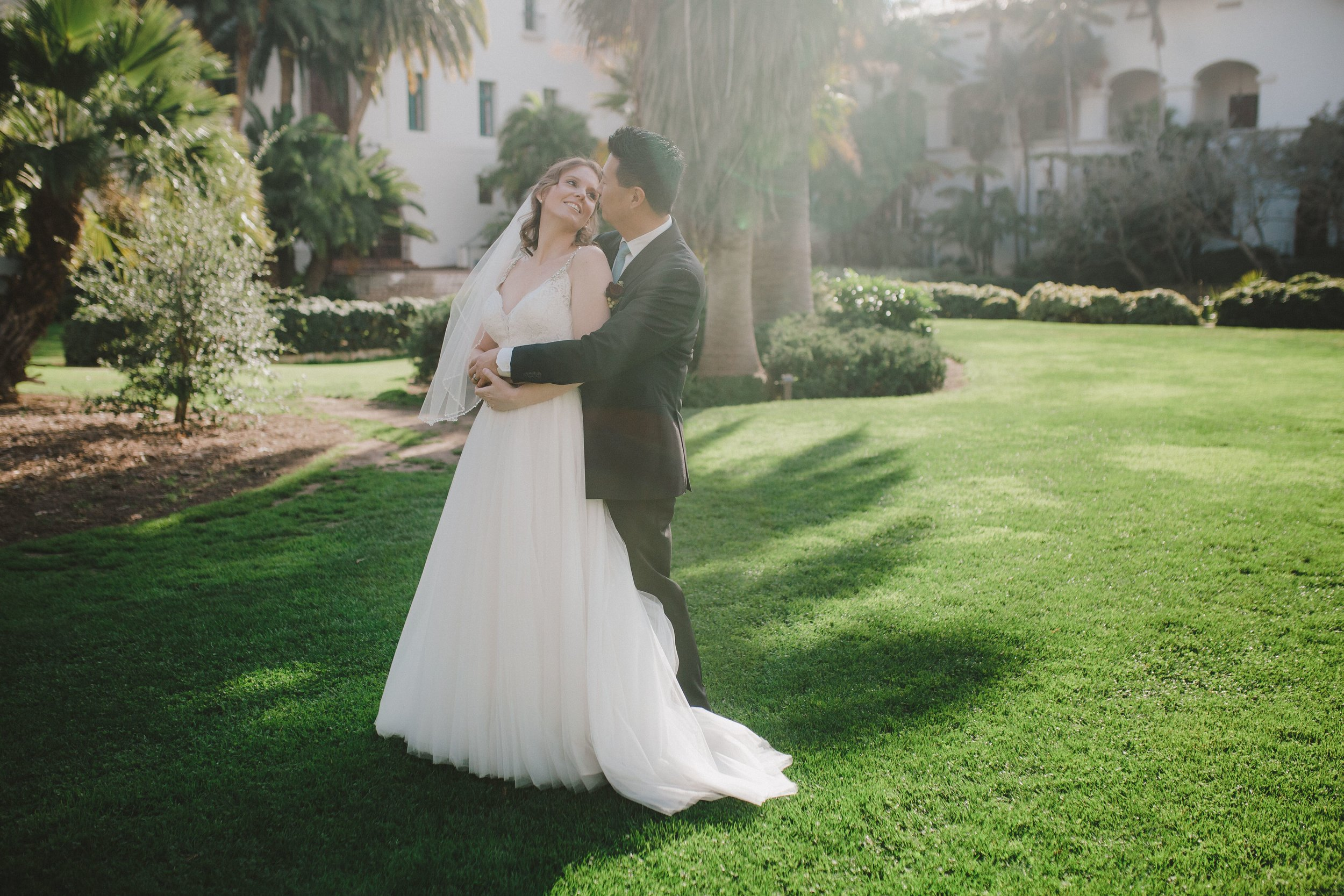 www.santabarbawedding.com | Venue: Santa Barbara Courthouse | Photography: Ryanne Bee Photography | Officiant: Santa Barbara Classic Weddings | Bride and Groom Embrace