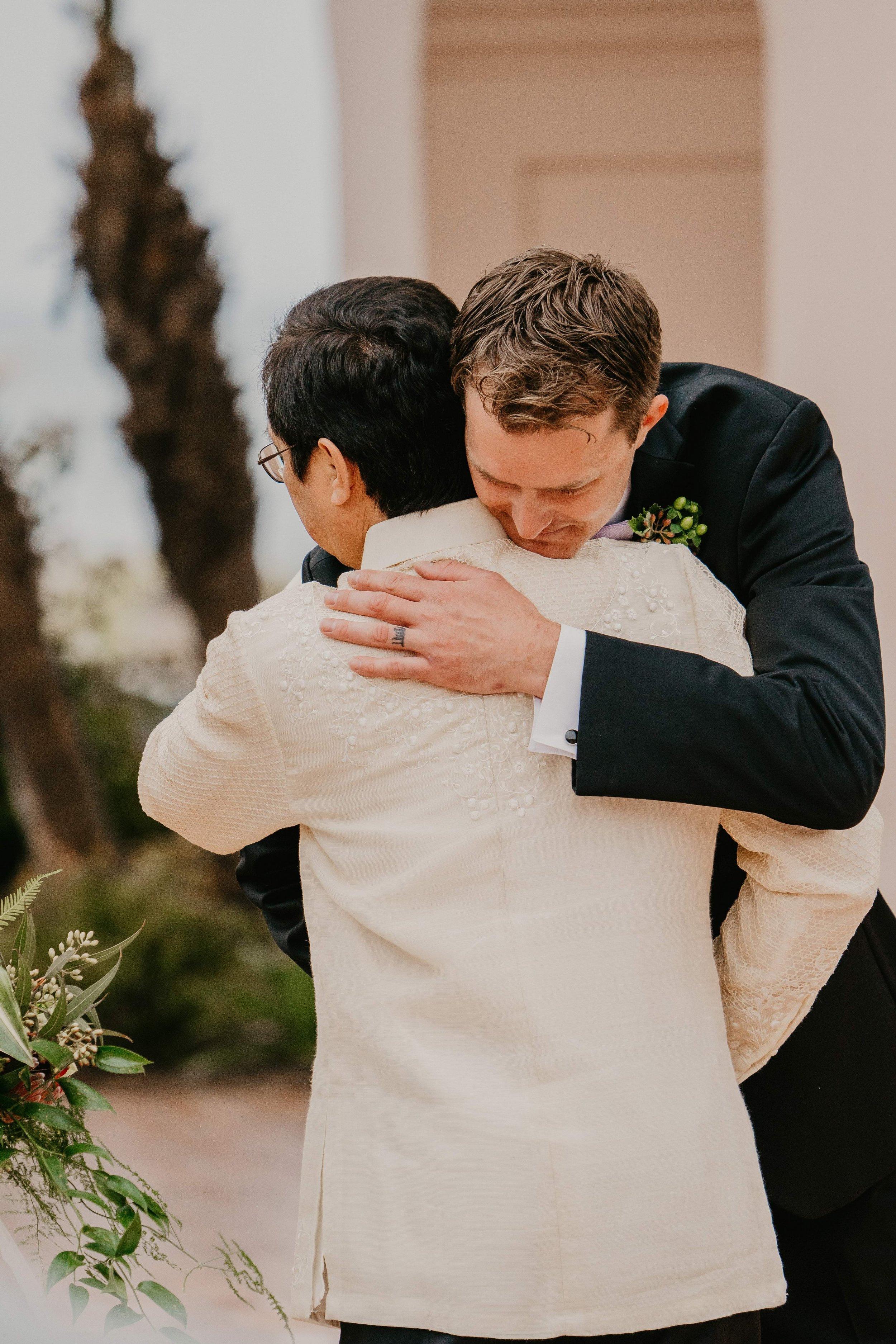 www.santabarbarawedding.com | Candice Marie Photography | Hilton Santa Barbara Beachfront Resort | Dalina Klan | Once in a Lifetime Weddings | Anthony Francisco | Groom Hugs Bride's Father