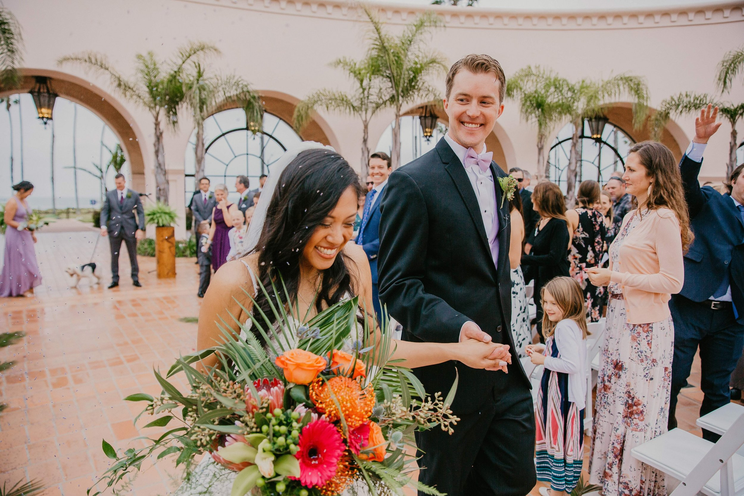 www.santabarbarawedding.com | Candice Marie Photography | Hilton Santa Barbara Beachfront Resort | Dalina Klan | Once in a Lifetime Weddings | Alpha Floral | Bride and Groom Leaving Ceremony