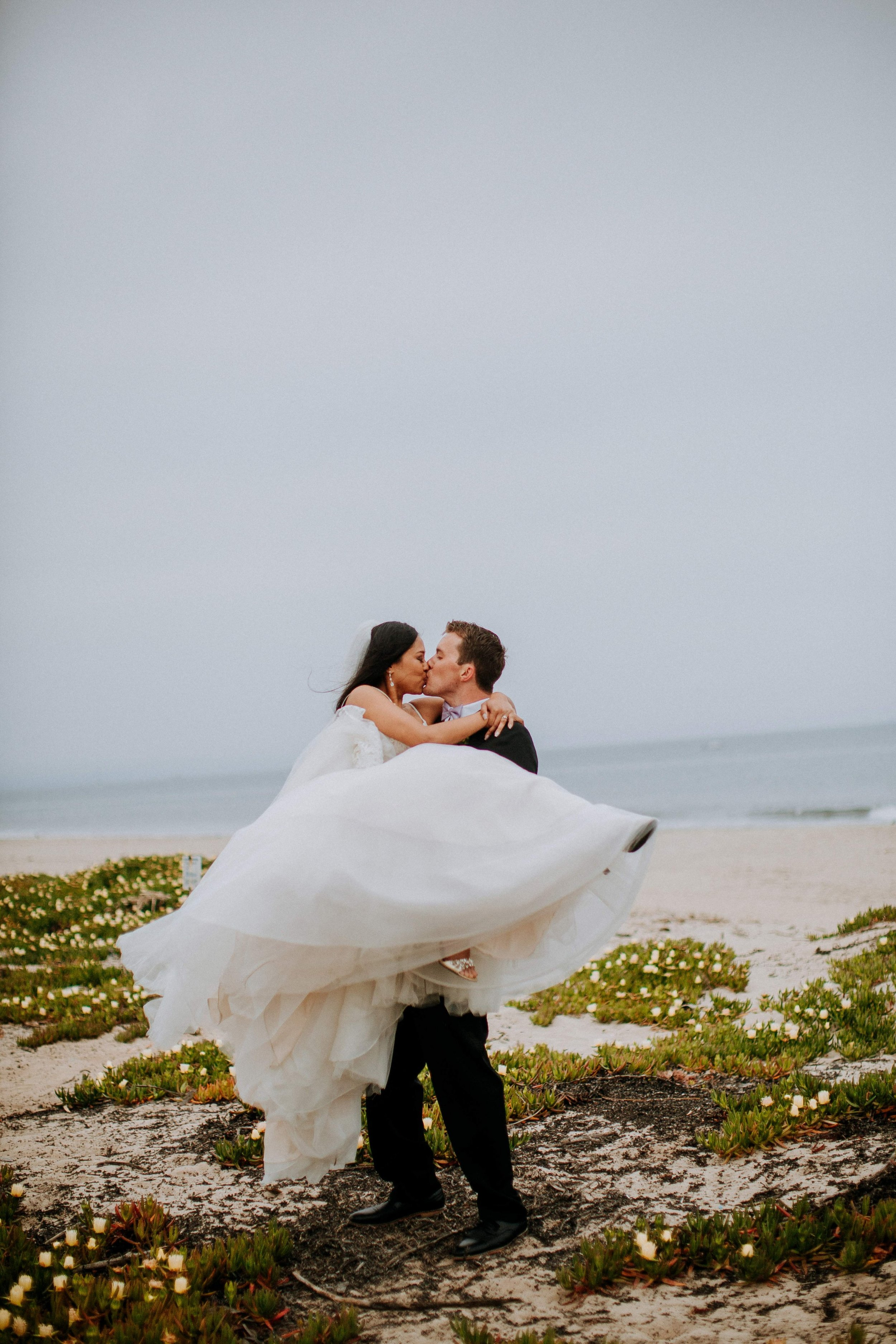 www.santabarbarawedding.com | Candice Marie Photography | Hilton Santa Barbara Beachfront Resort | Dalina Klan | Once in a Lifetime Weddings | Bride and Groom Share a Kiss on the Beach