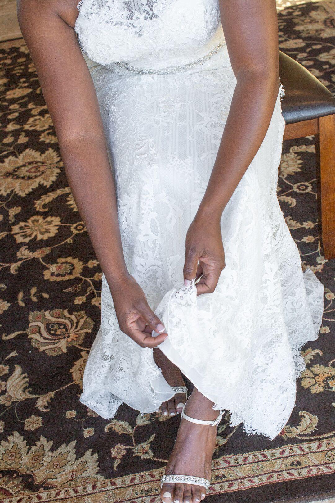 www.santabarbarawedding.com | Venue: The Casitas of Arroyo Grande | Photographer: Renoda Campbell Photography | Second Shooter: John Patrick Images |  Bride Adjusting Shoes
