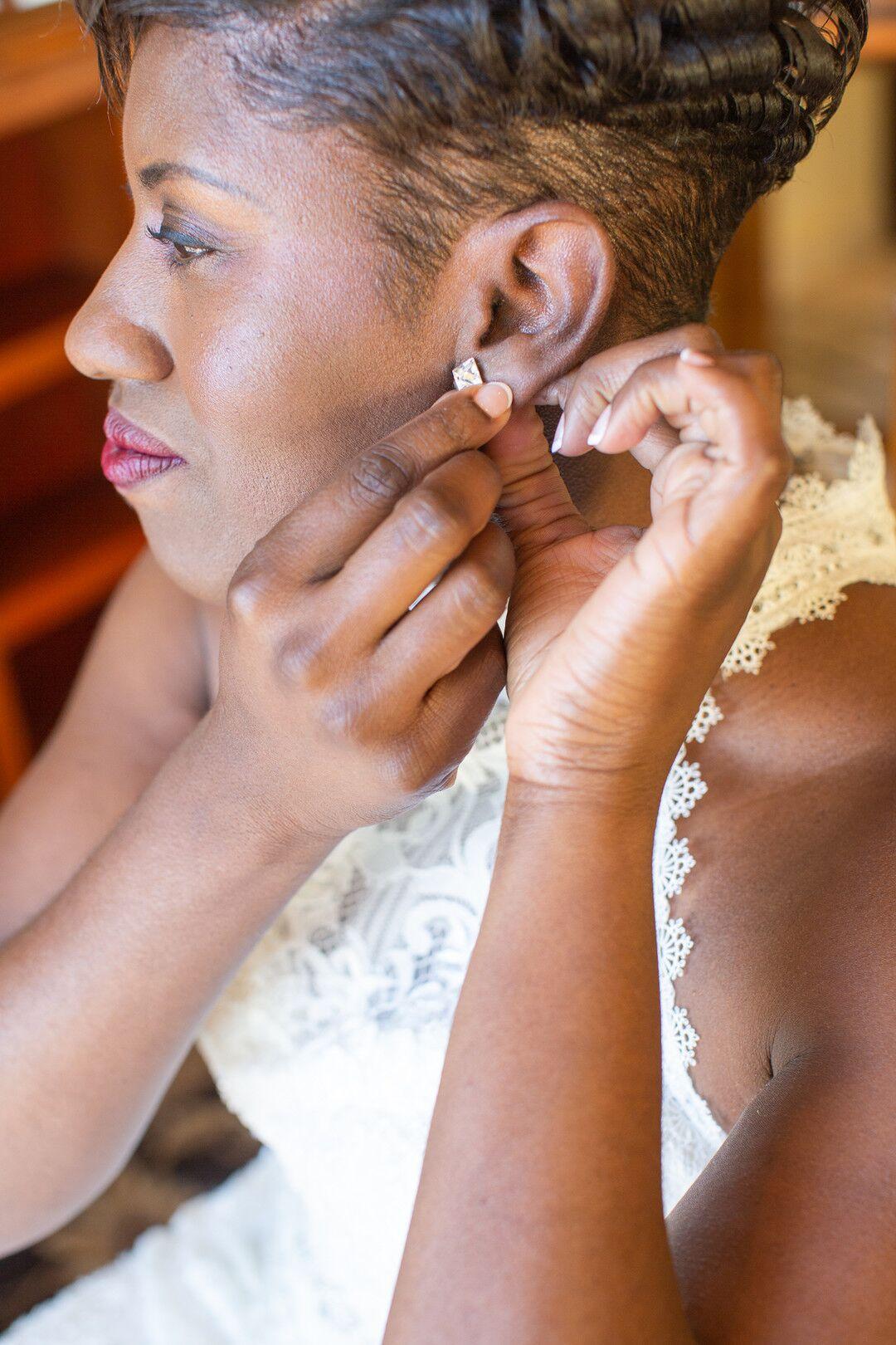 www.santabarbarawedding.com | Venue: The Casitas of Arroyo Grande | Photographer: Renoda Campbell Photography | Second Shooter: John Patrick Images |  Bride Placing Earrings