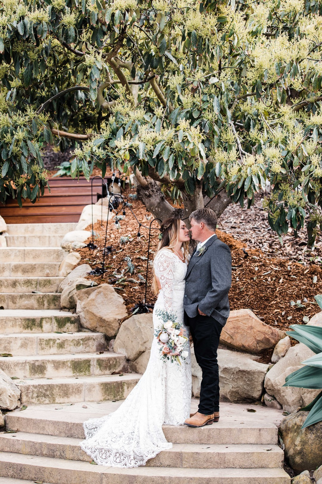 www.santabarbarawedding.com | Just Kiss Collective | Craddock Ranch | Alia Glasgow | Dulce Floral Design | Bride and Groom Share a Moment on the Stairs