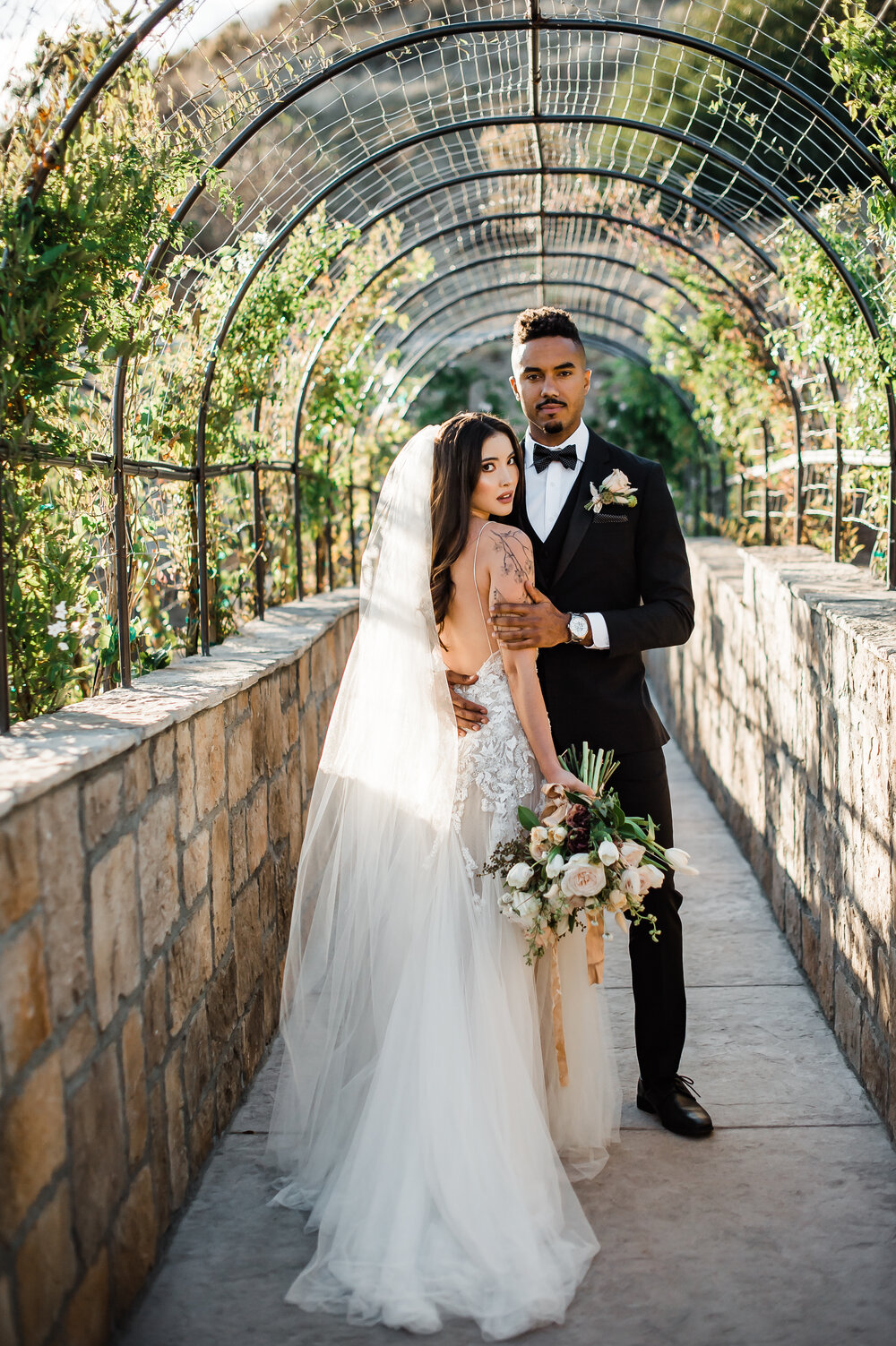 www.santabarbarawedding.com | The Tavern at Zaca Creek | Events by Fran | Michelle Ramirez Photography | Tangled Lotus | Friar Tux | Ever After Bridal | EmmaLinh | Bride and Groom Under Arch