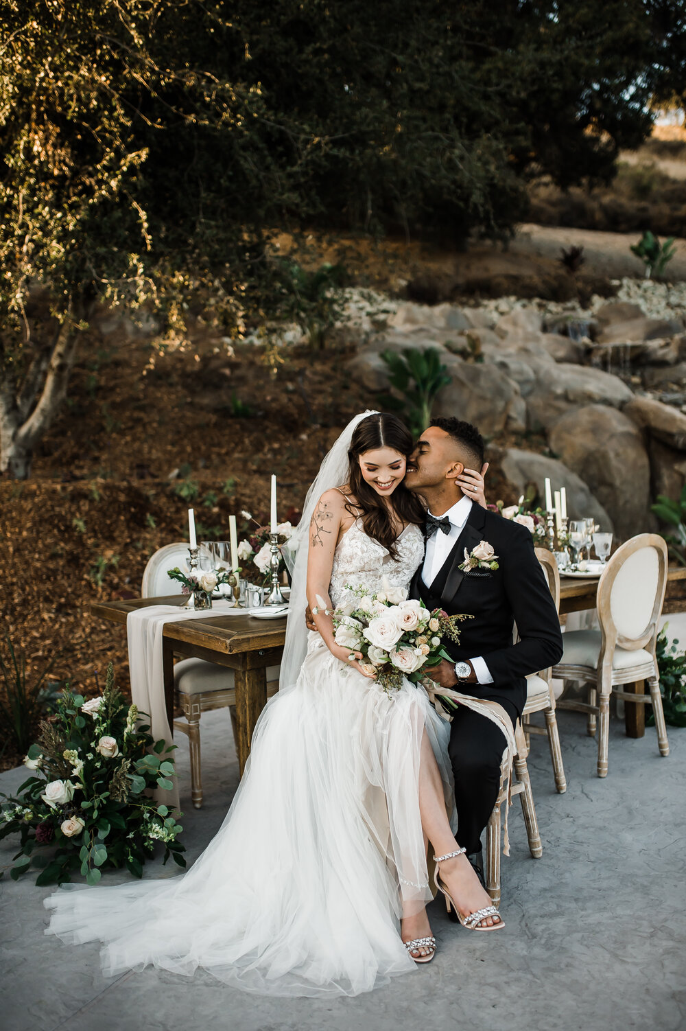 www.santabarbarawedding.com | The Tavern at Zaca Creek | Events by Fran | Michelle Ramirez Photography | Tangled Lotus | Friar Tux | Ever After Bridal | Badley Mischka | Bride and Groom at Table