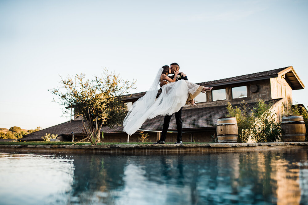 www.santabarbarawedding.com | The Tavern at Zaca Creek | Events by Fran | Michelle Ramirez Photography | Tangled Lotus | Friar Tux | Ever After Bridal | Jackie Romero | Bride and Groom by Pool