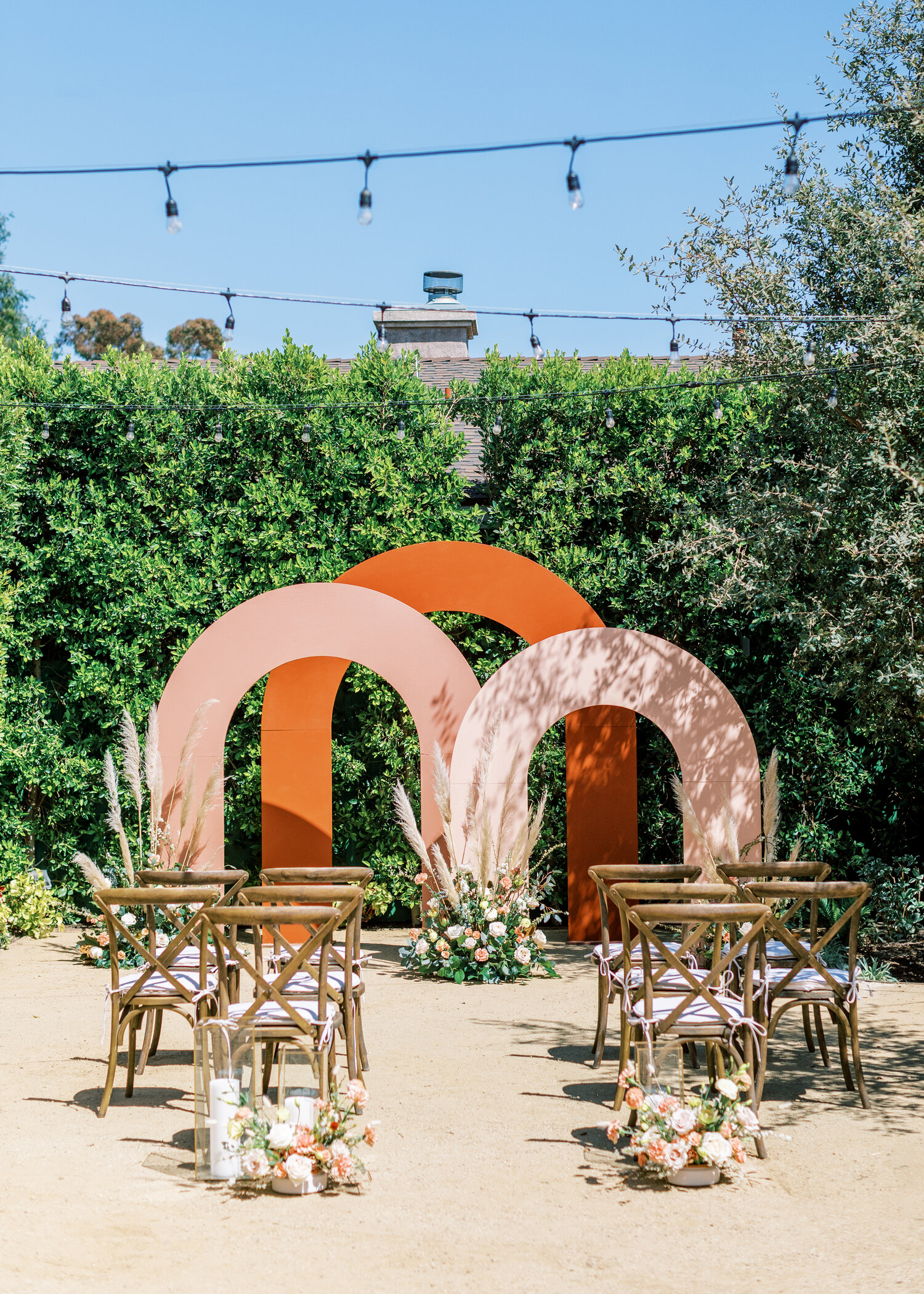 www.santabarbarawedding.com   Events by Fran   Ever After Petite Venue   Kendall Ann Photo   Tangled Lotus   Amigo Party Rentals   Harpist VeeRonna   The Ceremony Set Up with Rainbow Arches