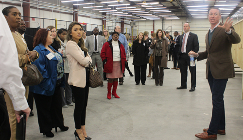 Attendees tour the AWTC training facility.