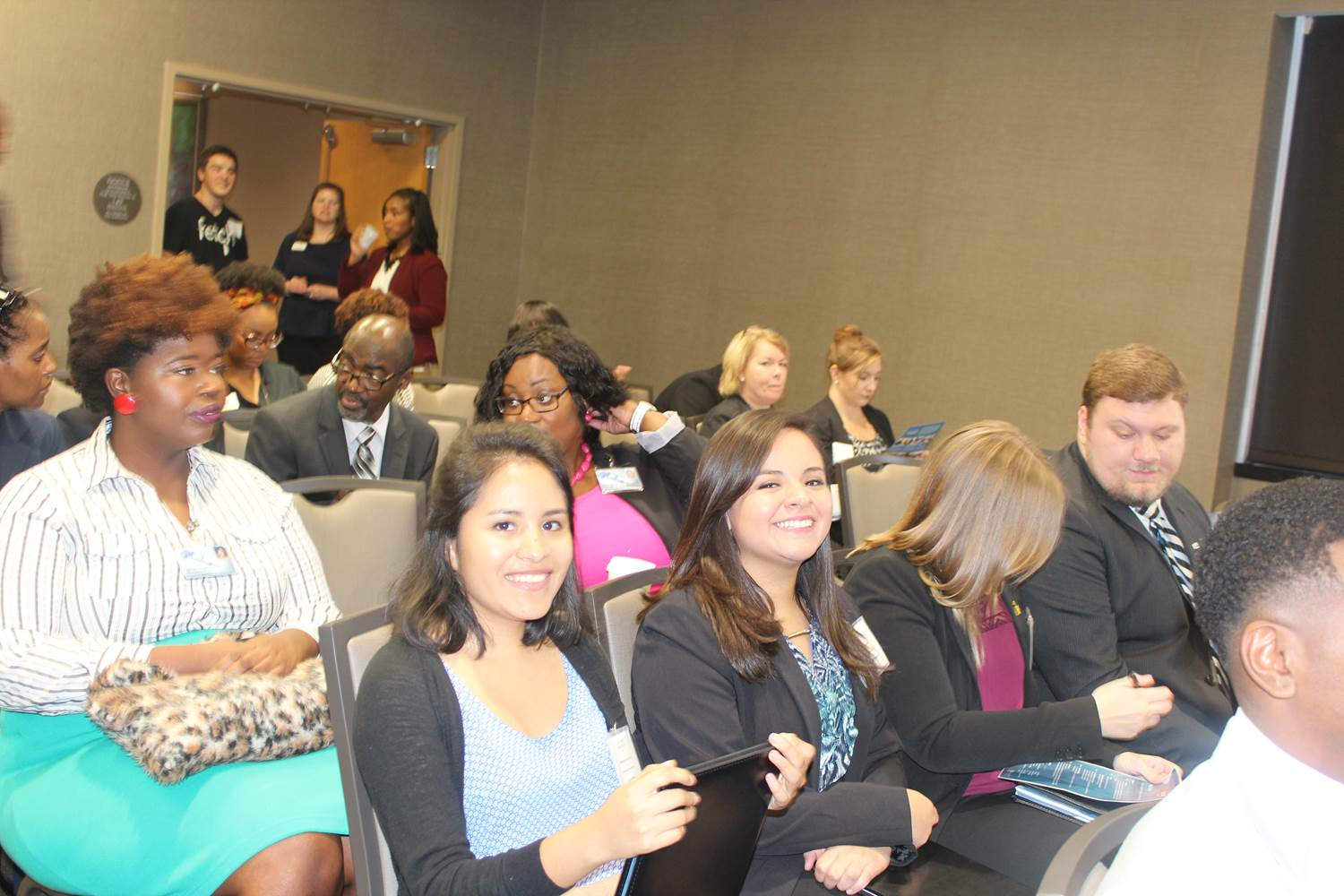 "Attendees await the beginning of the ""What It Takes to Win the Job"" panel discussion at the TRP event."