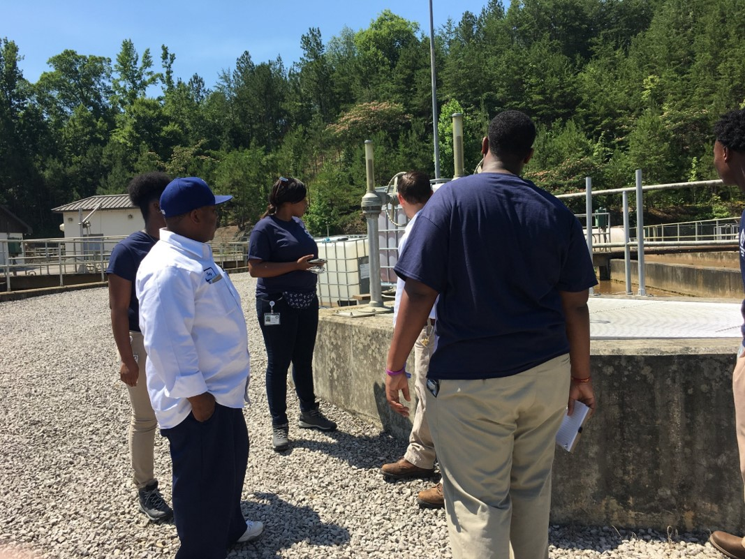 Interns tour Prudes Creek Water Reclamation Facility with Jefferson County's Environmental Services Department staff members.