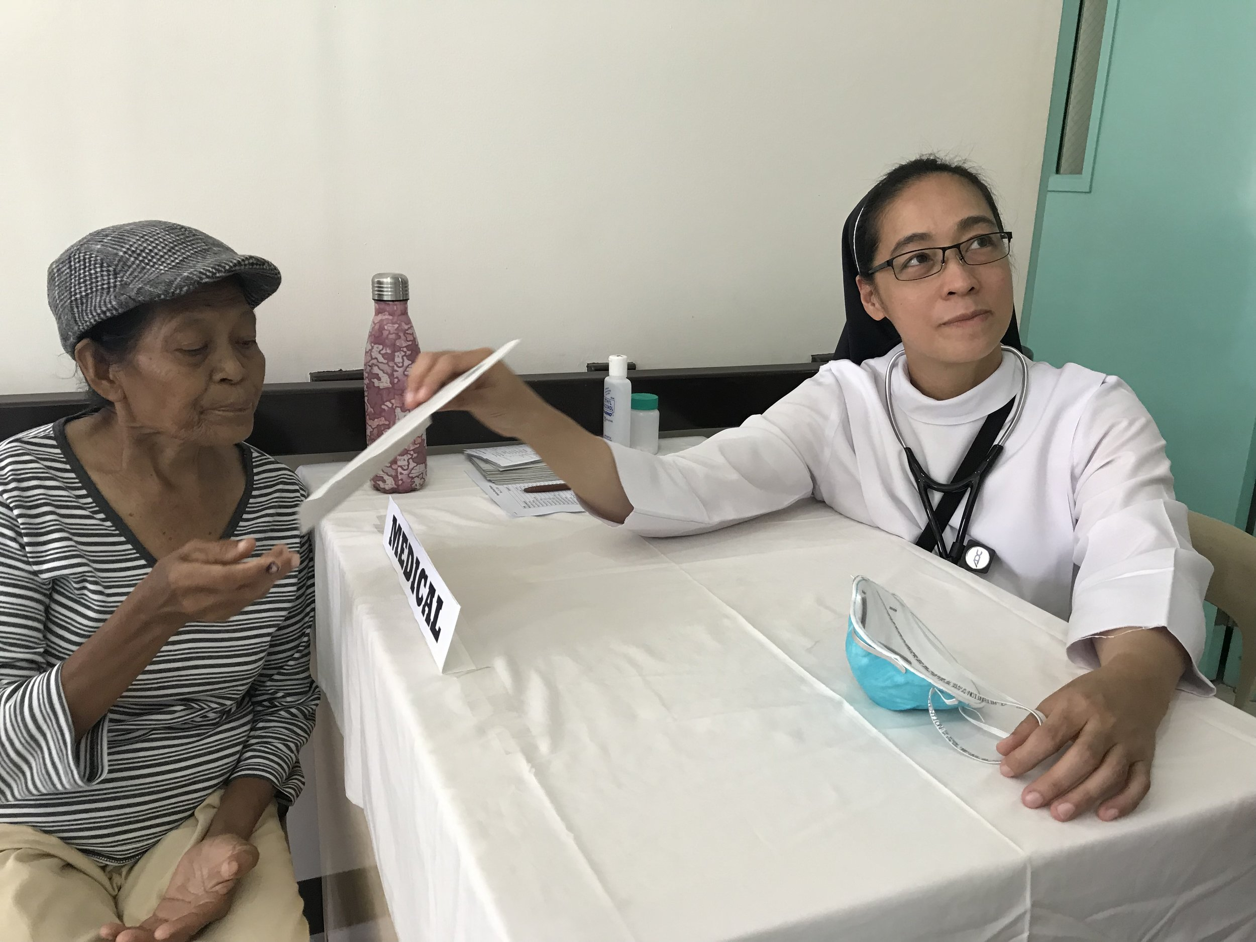 Sister Gertrude Bataan, MD with patient.