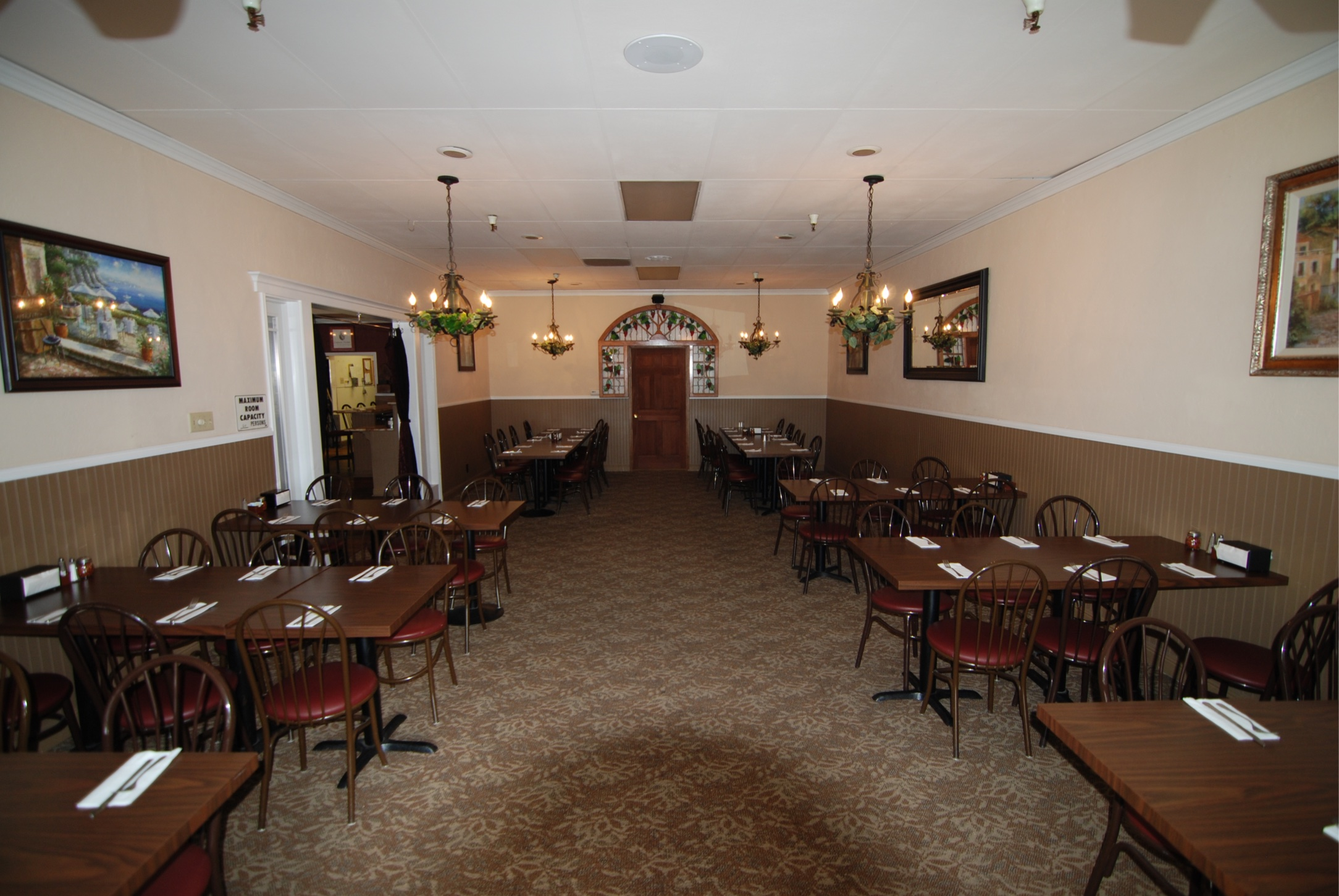 "Our private banquet room seats up to 60 guests and has an HD projector, 100"" screen, and 4 speakers."