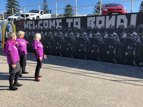 Local Grandmothers reflecting on the mural.