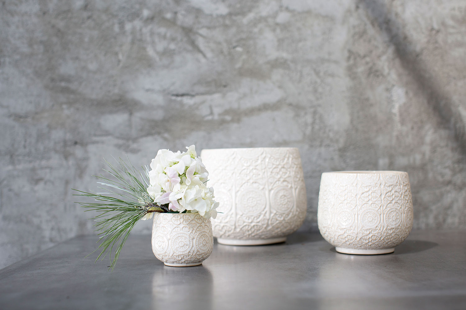 Francis Pot - This ceramic vase has a subtle imprinted design. Perfect for drop in pots or centerpiece design.