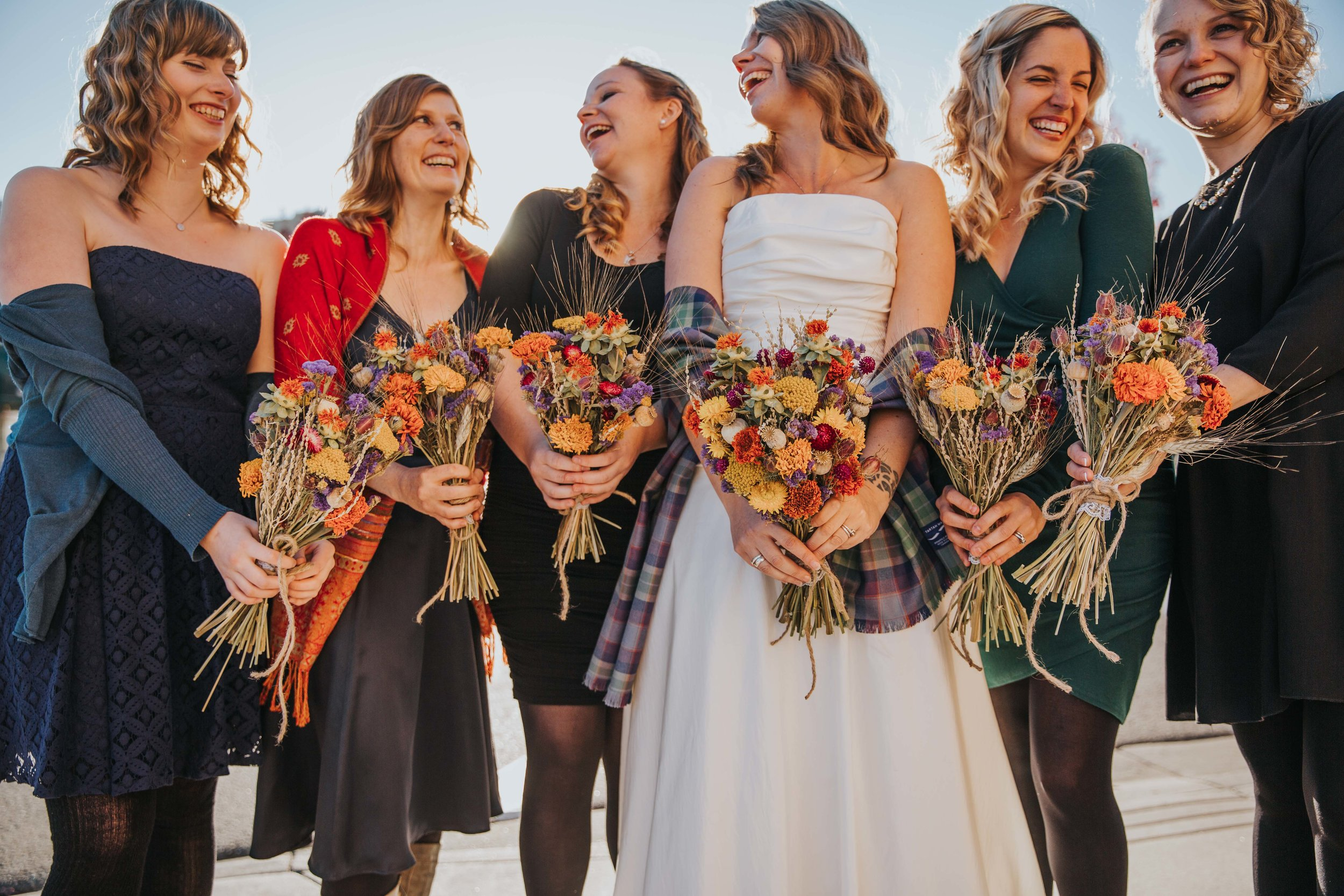 We've even had fall brides who wanted to keep things local, have us make their bouquets with dried flowers!  Photo: Charlotte Truant Lota Love Photography