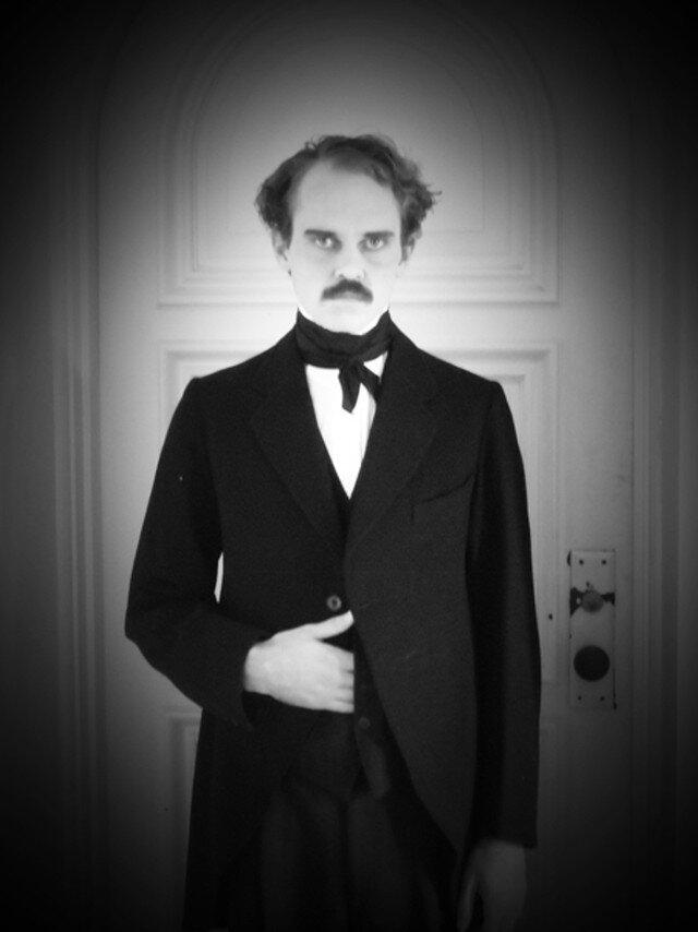 Alastair Morley Jaques in costume as Edgar Allan Poe.