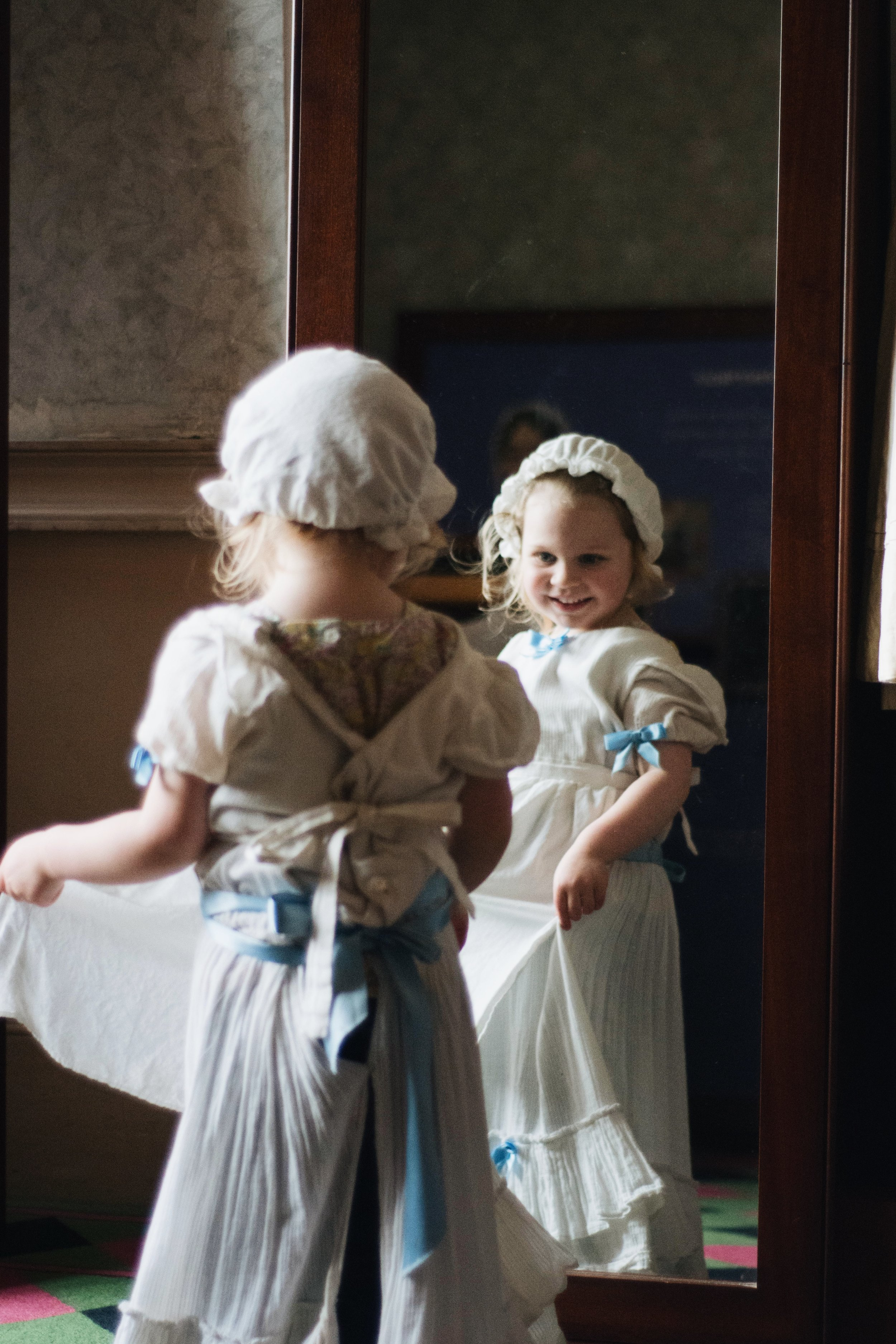 Of course Sophie LOVED trying on the dresses.