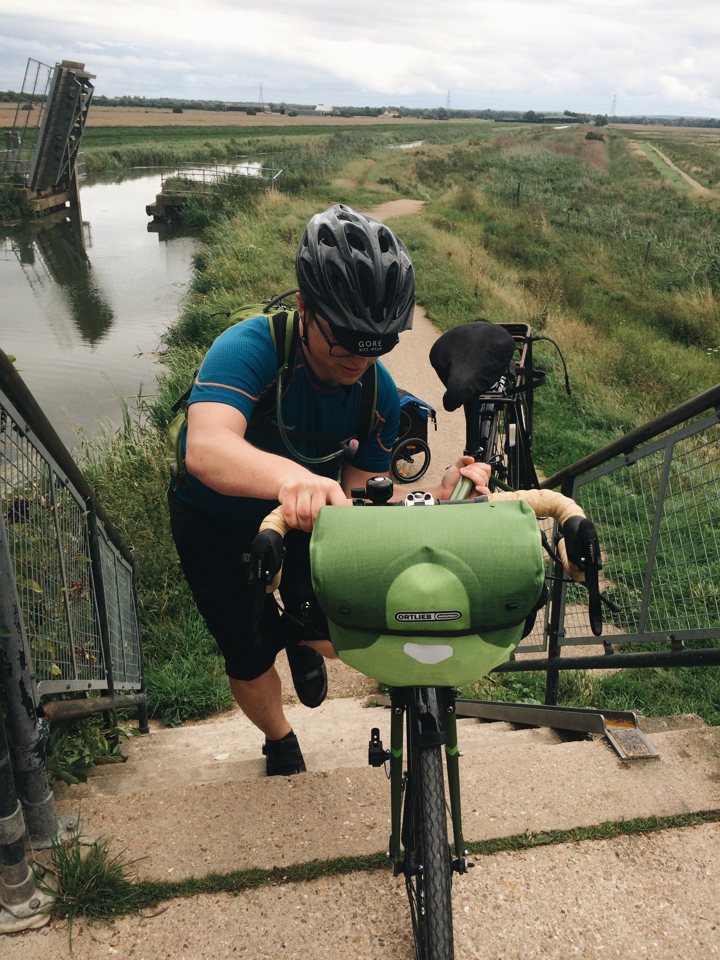 Crossing the footbridge at Wicken Fen. You can see a draw bridge in the background. It'd be awesome if sustrans could negotiate the use of that bridge for cycles... Because unloading the bikes to cross the bridge is a waste of 20 minutes...
