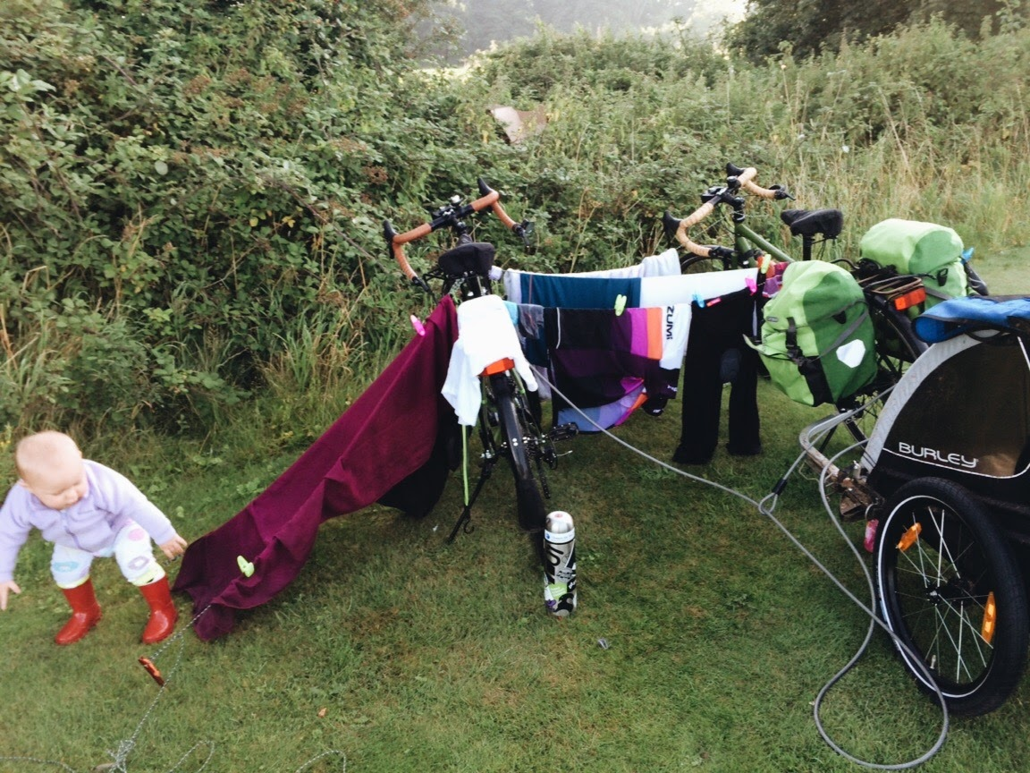 My impromptu clothesline. I dunno why I locked the bikes up... They'd have a dickens of a time stealing the bikes (right outside our tent) with all those clothes on them...