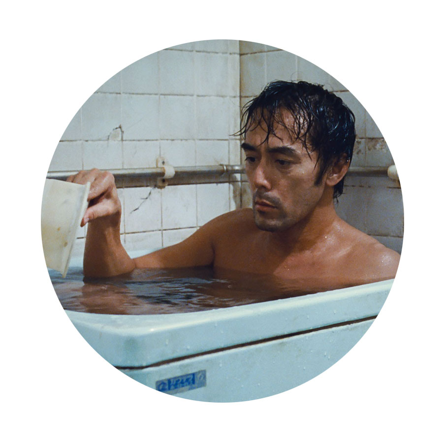 Returning to the Forum, sou'wester on, ready for the typhoon of   film 27, AFTER THE STORM ( Umi Yorimo Mada Fukaku ) (D/S Hirokazu Kore-eda)  .