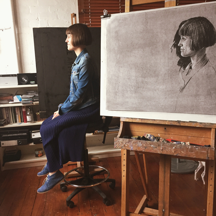 Louise on paper . (By Shane Jones.) Louise seated. In the studio.