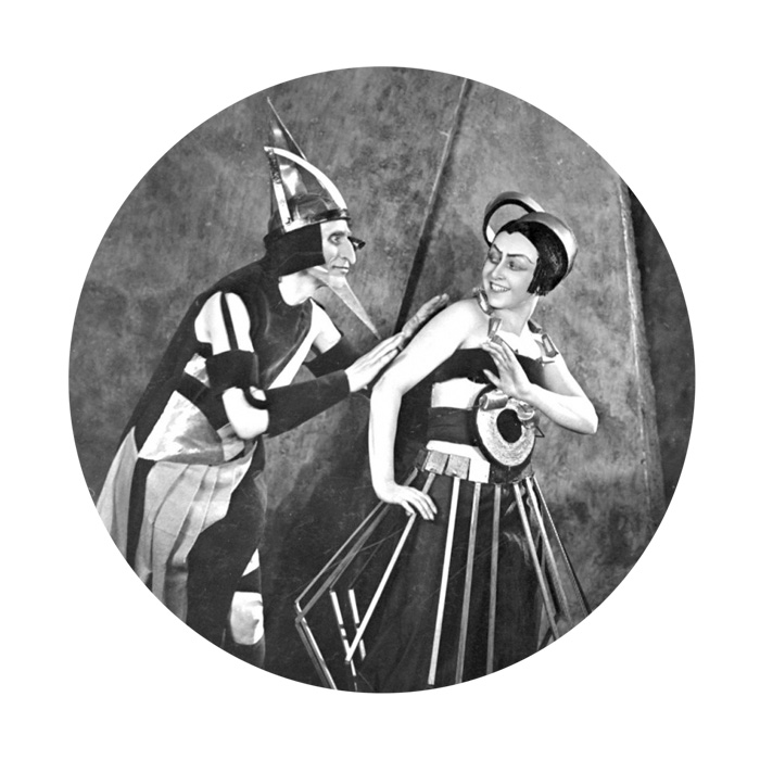 """Be still the heart. Alexandra Exter's (1882–1949)   costume   and set design for AELITA. If I can't live in a remote hut in SPOOR, surrounded by deer, stoats, boars, and magpies with an eye for all things shiny,   perhaps constructivist Mars  , for something different. Draw my eyebrows like yours, Yuliya Solntseva. Frame me in a geometric shape, Nikolai Tsereteli. Film 50 belongs to   AELITA, QUEEN OF MARS   (D Jakov Protazanov), which the New York Times referred to in 1929 as being """"far more interesting to read about than to gaze upon"""". Pluto to that! Let me wear one of your Martian costumes, Alexandra Exter, and feel as though I am hovering in a machine age of aluminum, glass, acrylics, and steel. 1924, in motion.  Postscript:   With big love   to I DREAM IN ANOTHER LANGUAGE; RAILWAY SLEEPERS; AELITA (costumes and set, and live score by The Spheres); UNTIL THE BIRDS RETURN; CALL ME BY YOUR NAME."""