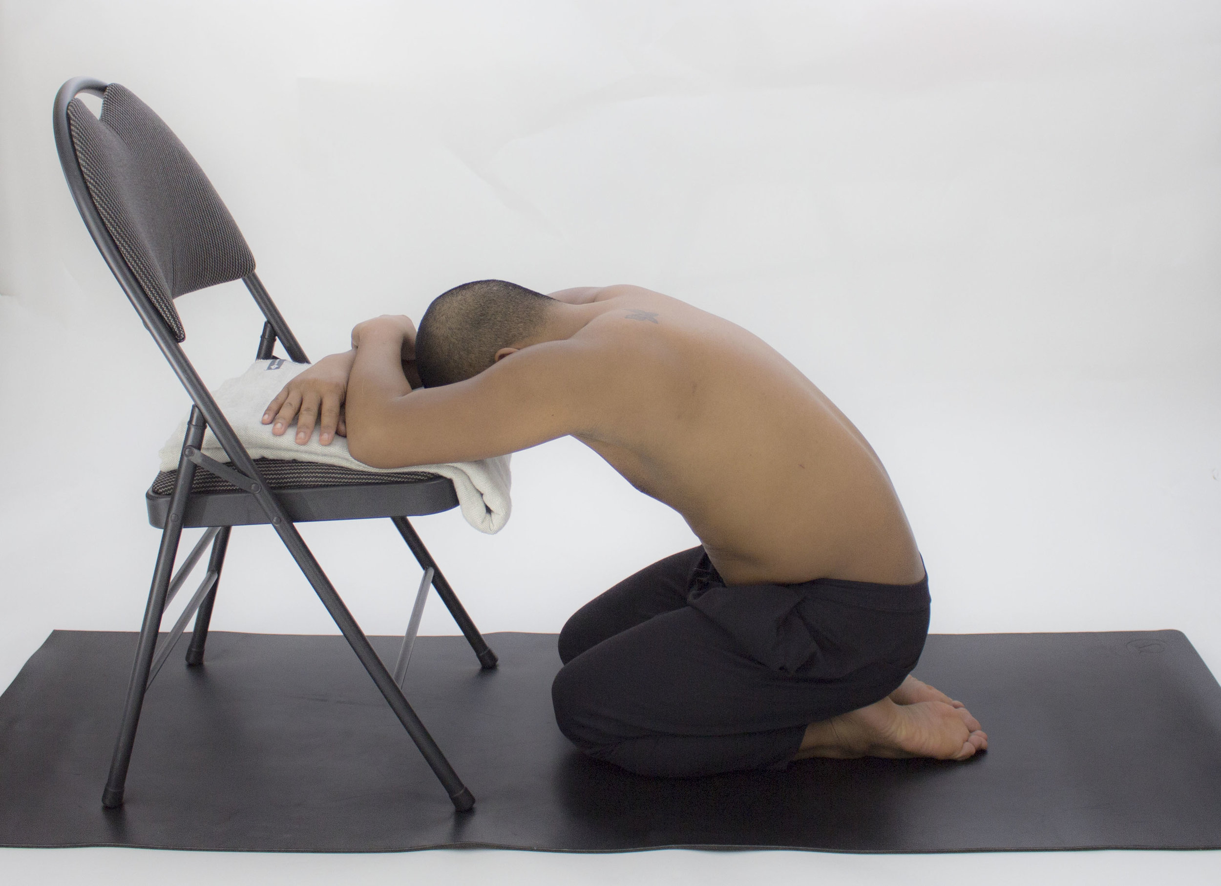 One on one training helps with your unique requirements. Tailoring your work out plan or yoga classes to suit needs and requests. image: assisted yoga pose, props are helpful tools in posture modification. Props are provided during sessions.