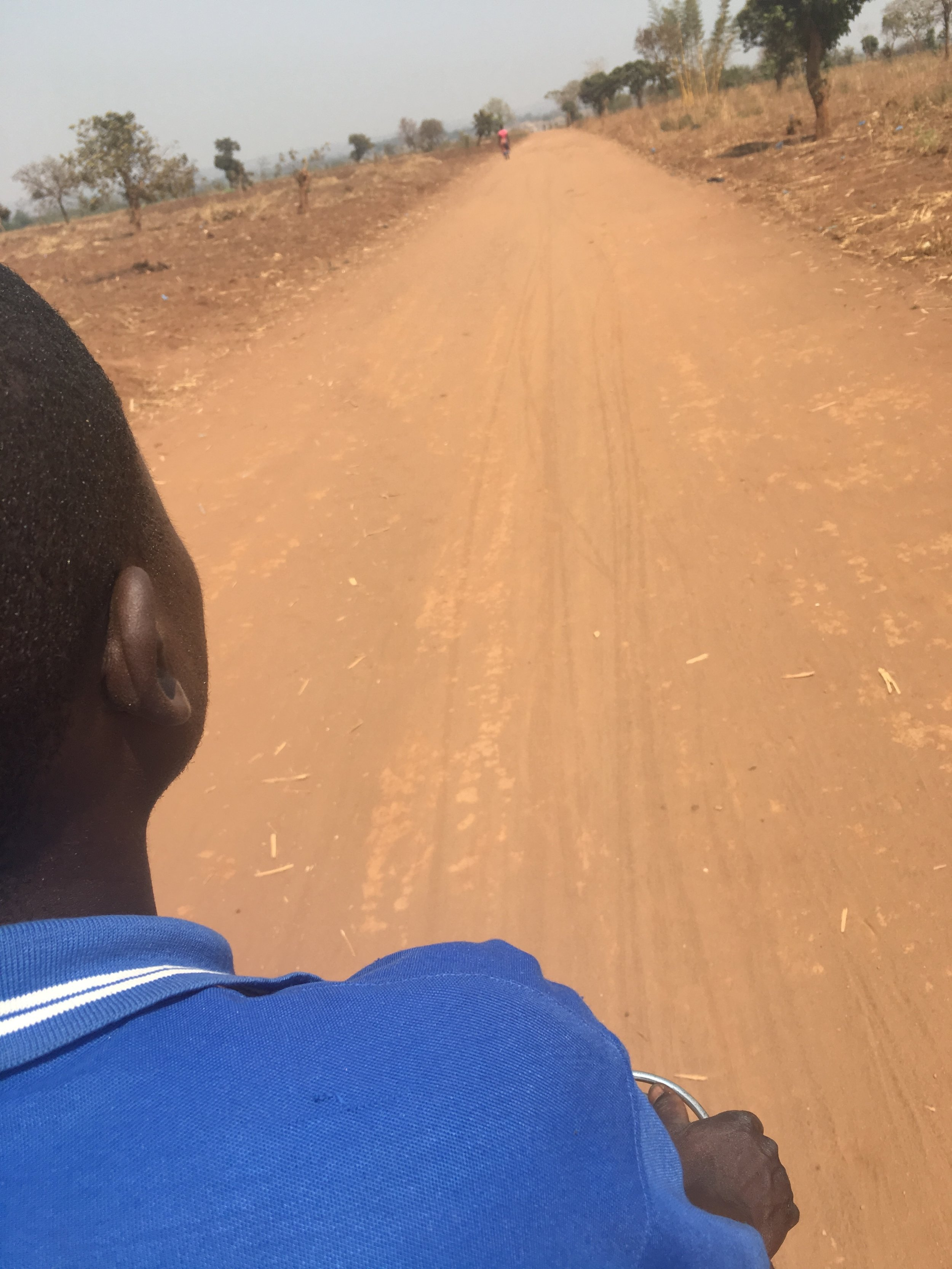 Riding on the back of a kabaza to our scholar's home!