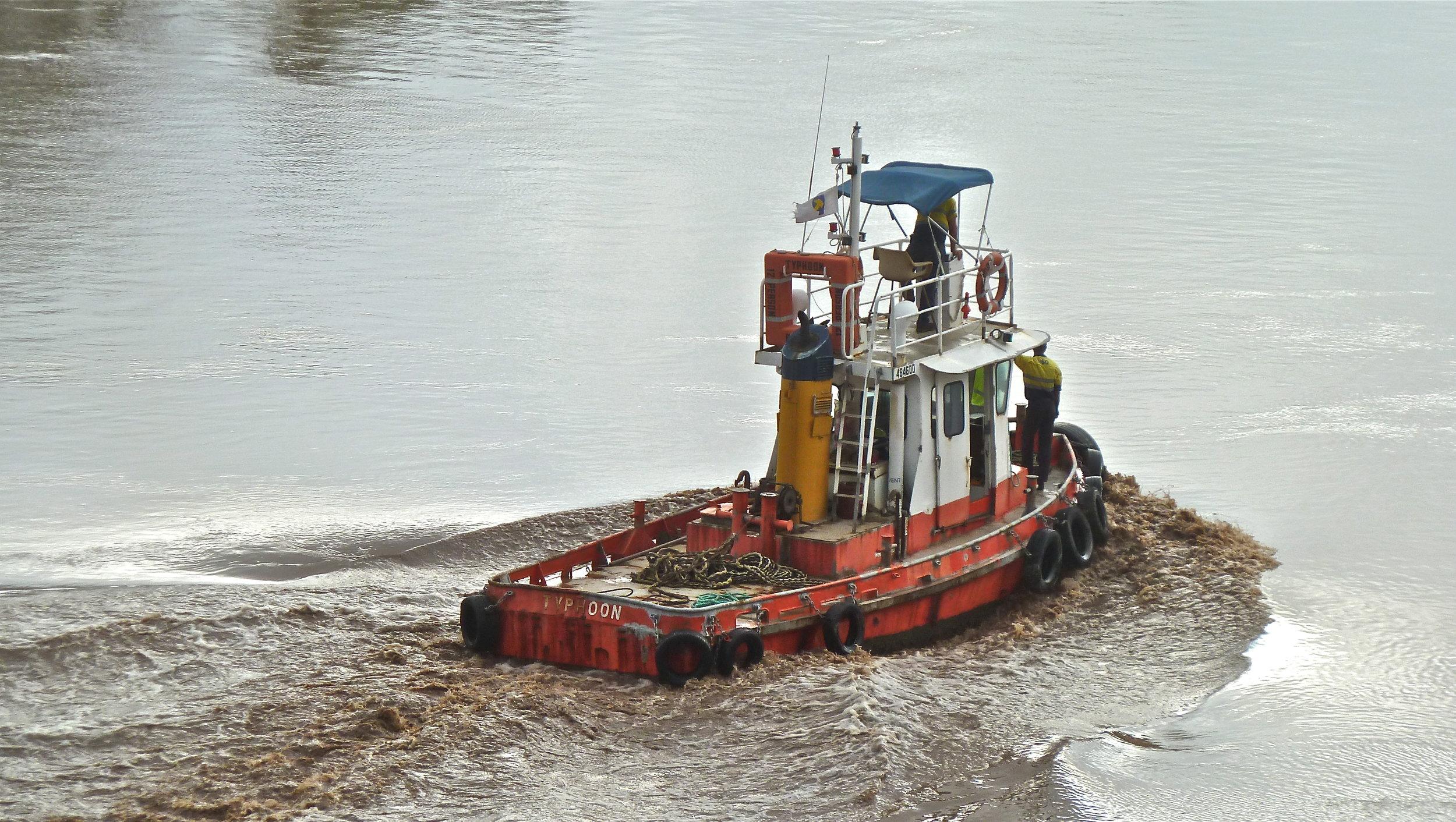 Jan:  tug battling swollen Brisbane River