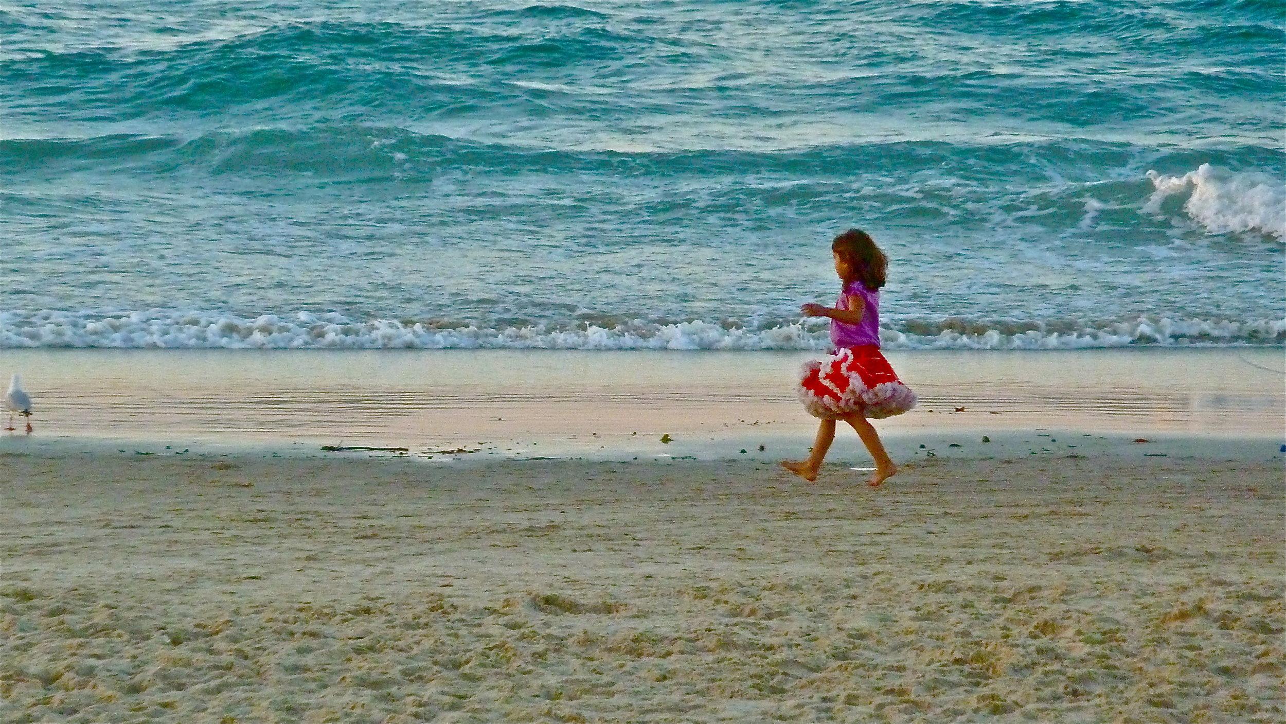 Oct:  Girl and gull, Main Beach, Byron Bay, New South Wales