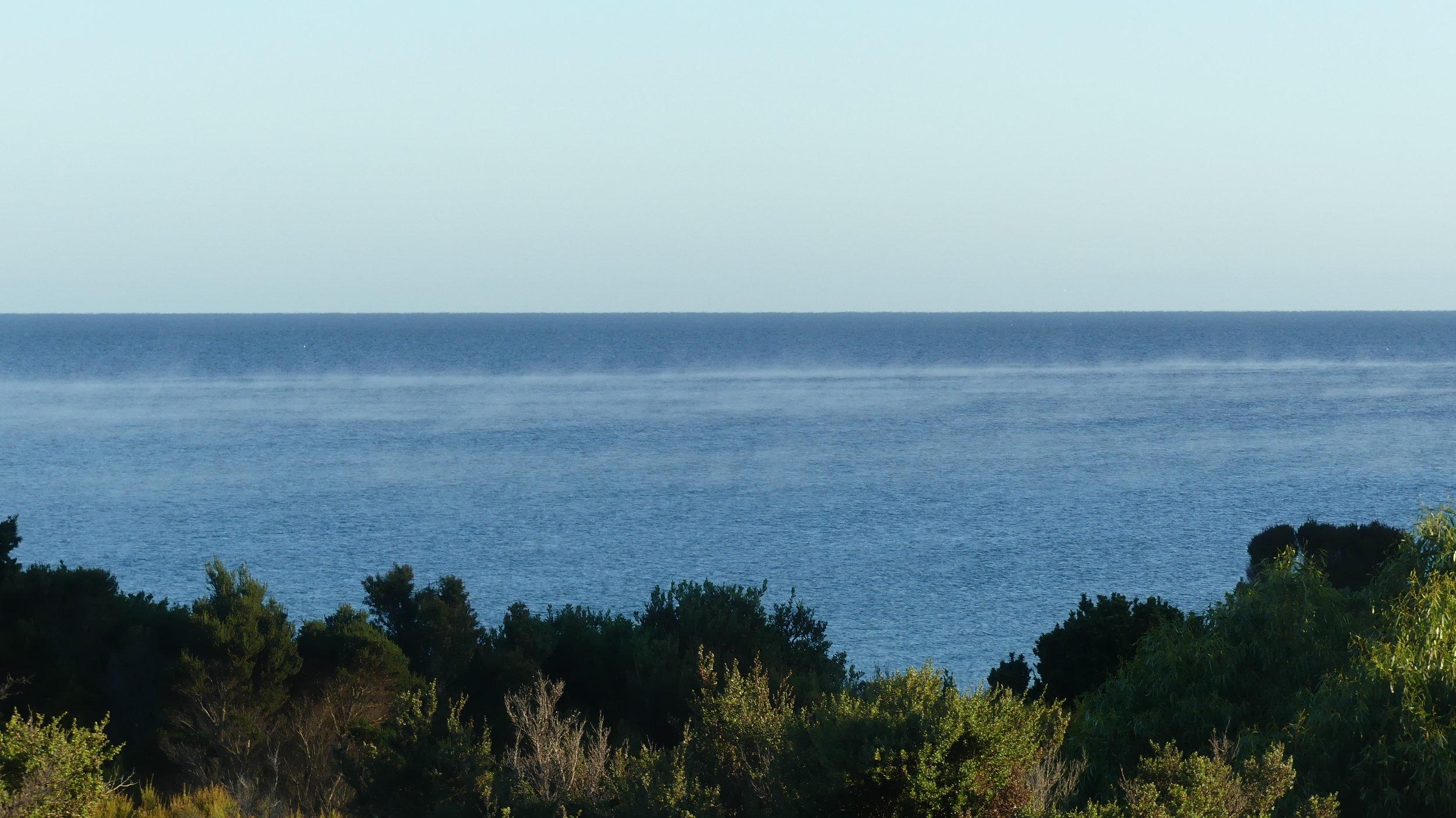 Whispy mist o'er the sea