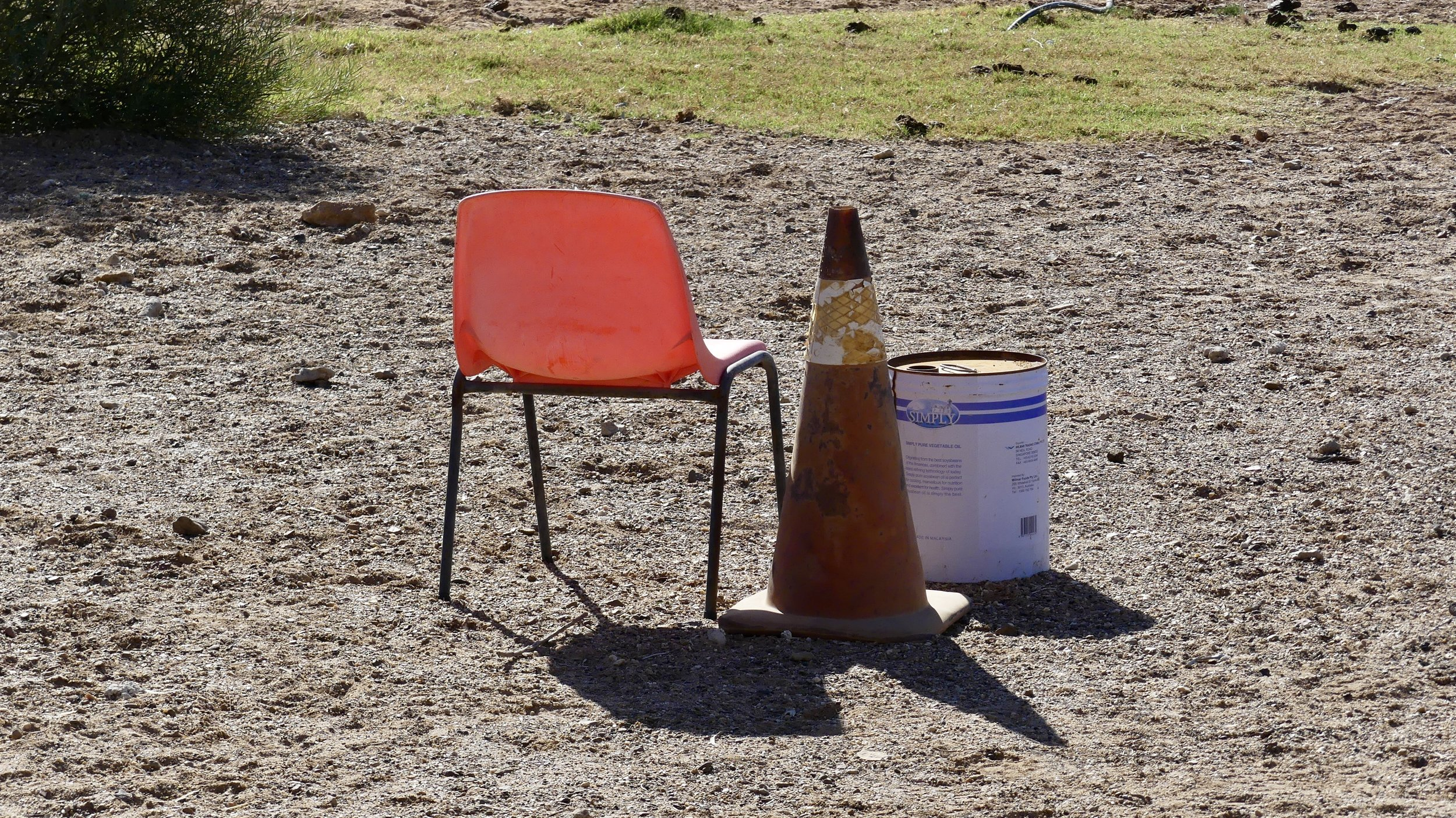 Still life: table, chair, traffic cone