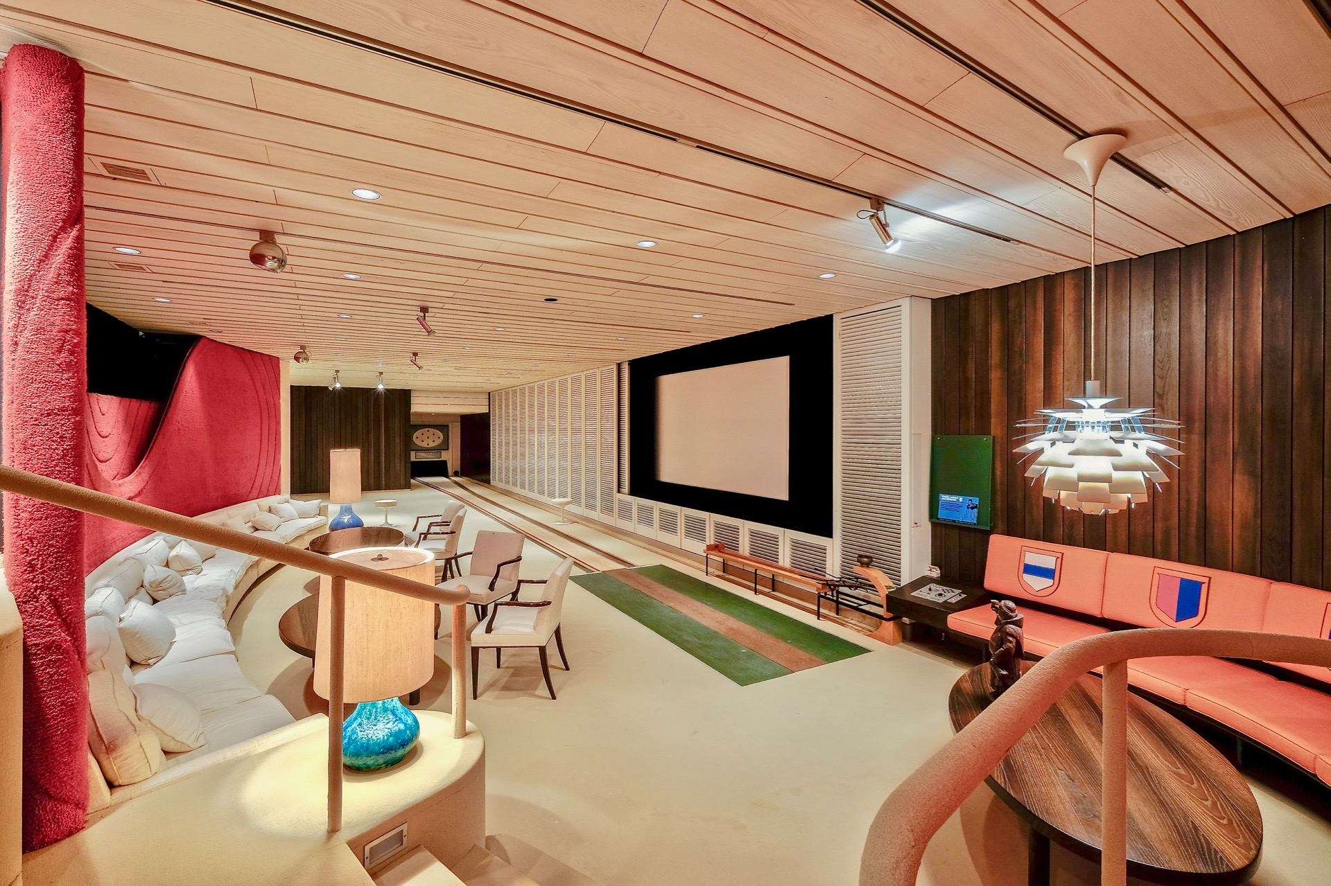 This secluded Swiss retreat has a host of ultra-luxurious amenities including a plush midcentury modern bowling lounge.