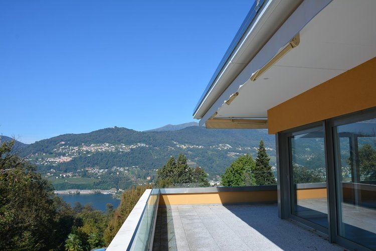 "Residence ""Villa Vigan"", luxurious penthouse in Lugano for sale. Click the image for more information."