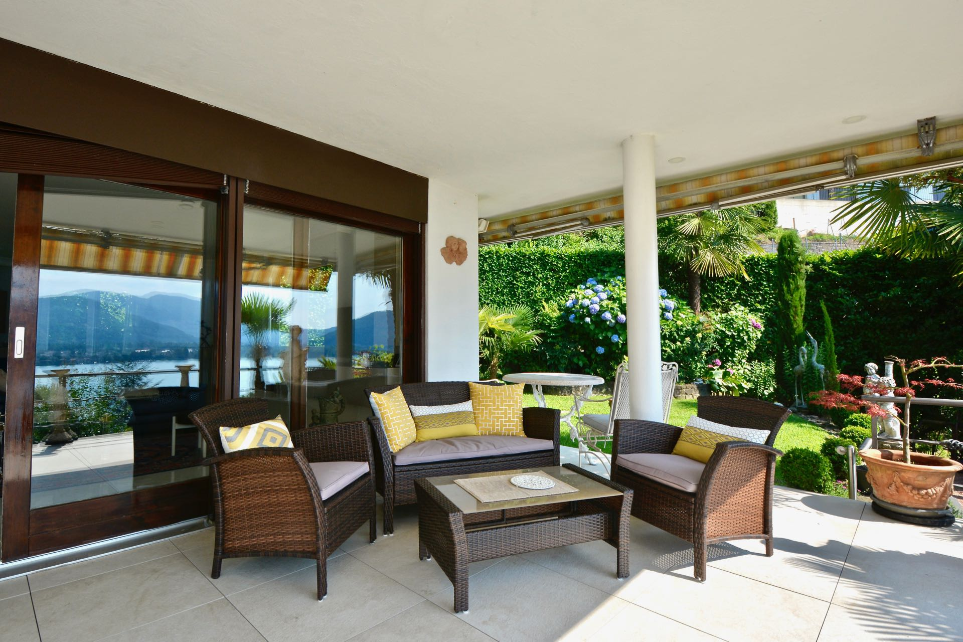 Beautiful portico with direct access to the private garden,Duplex apartment in Montagnola, Switzerland for sale with wonderful Lake Lugano view