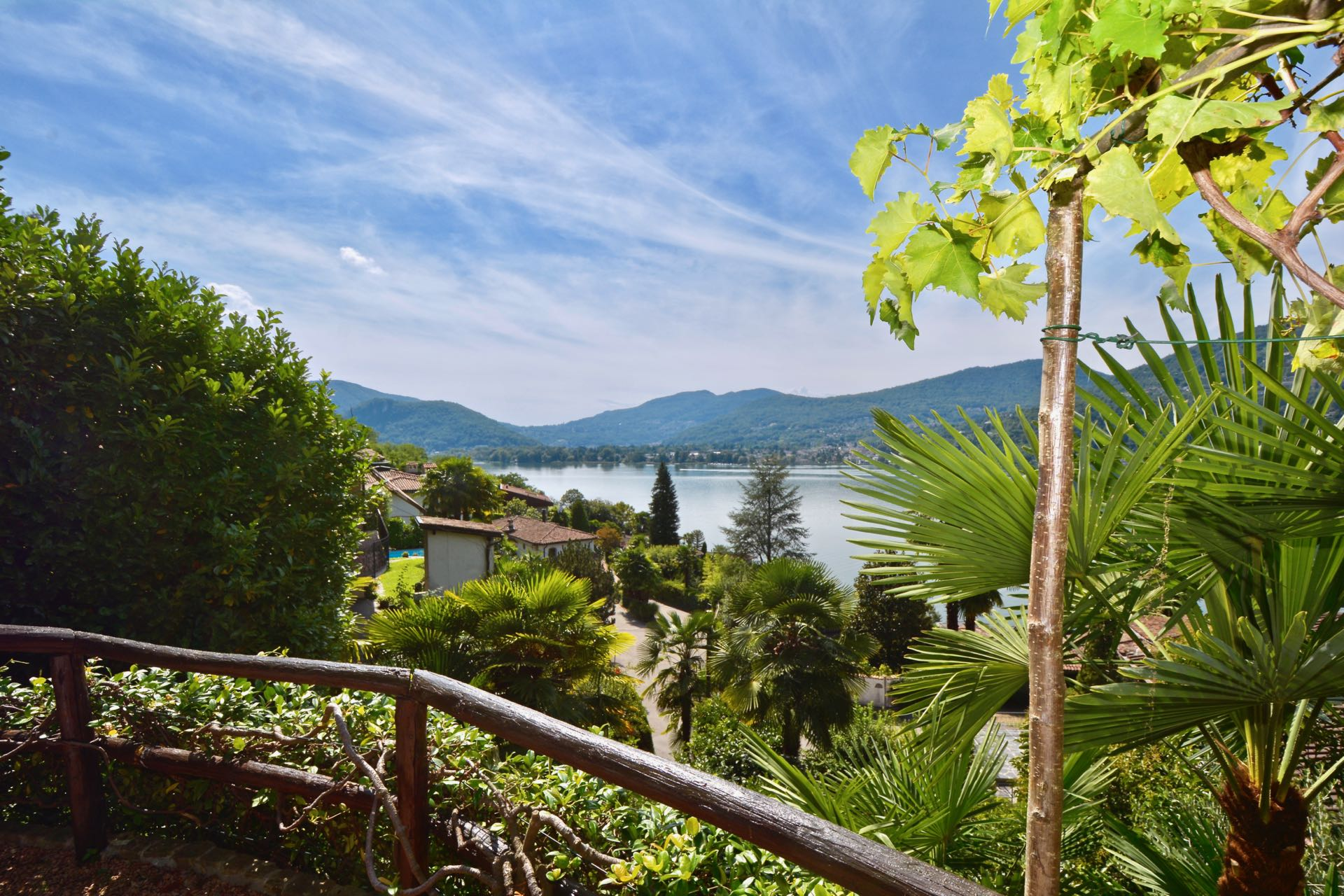 Panoramic view to Lake Lugano from the terrace,Duplex apartment in Montagnola, Switzerland for sale with wonderful Lake Lugano view