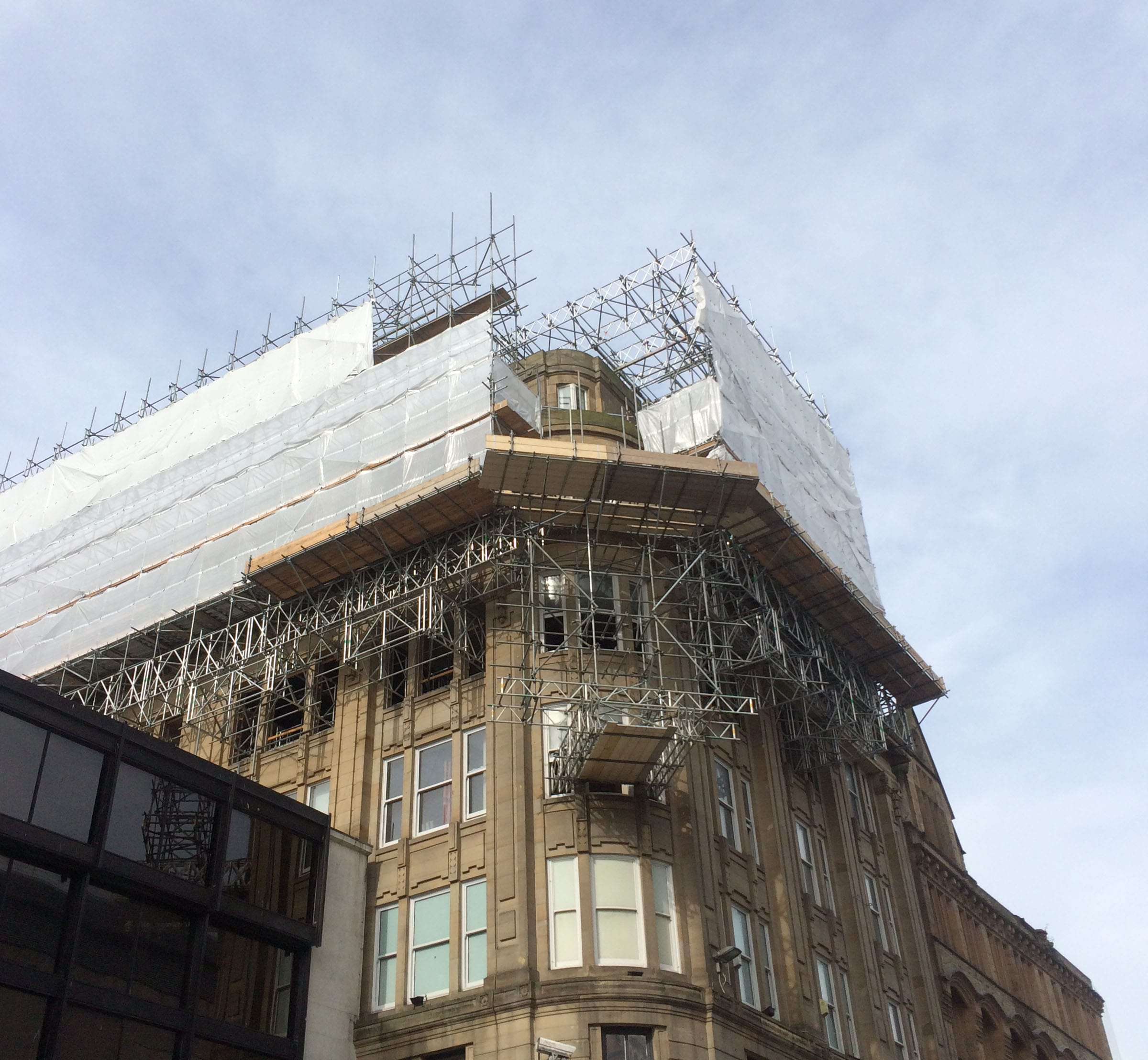 Coopers building cantilevered scaffold for refurbishment work