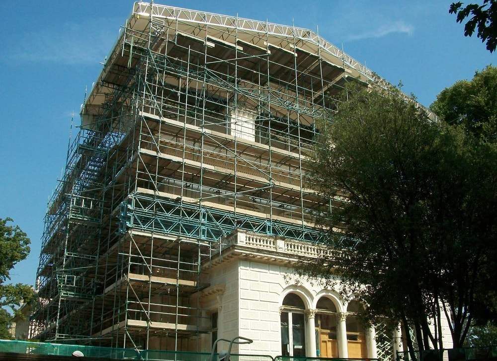 Temporary roof suspended on independent scaffold access