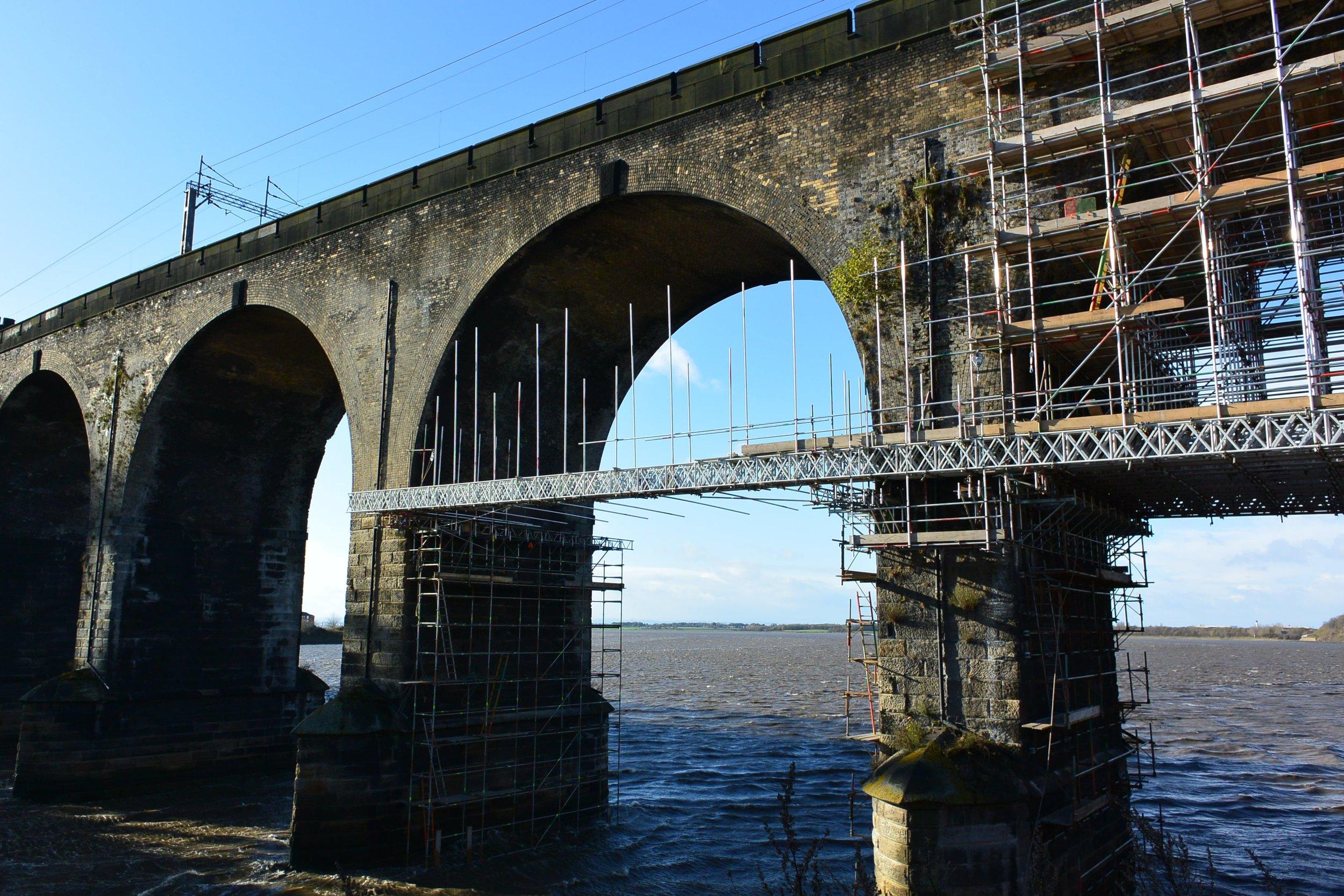 Bridged lattice beam scaffold structure spanning underneath the Runcorn Bridge