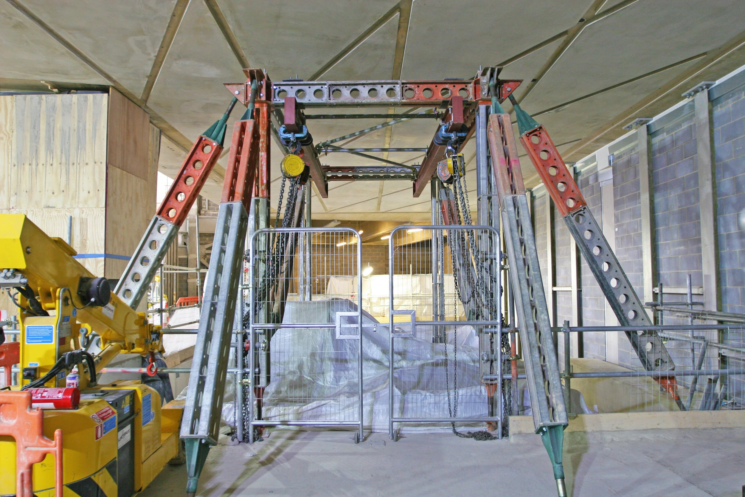 Lifting frame using RMD SuperSlim soldiers for the installation of escalators at Crossrail, Farringdon