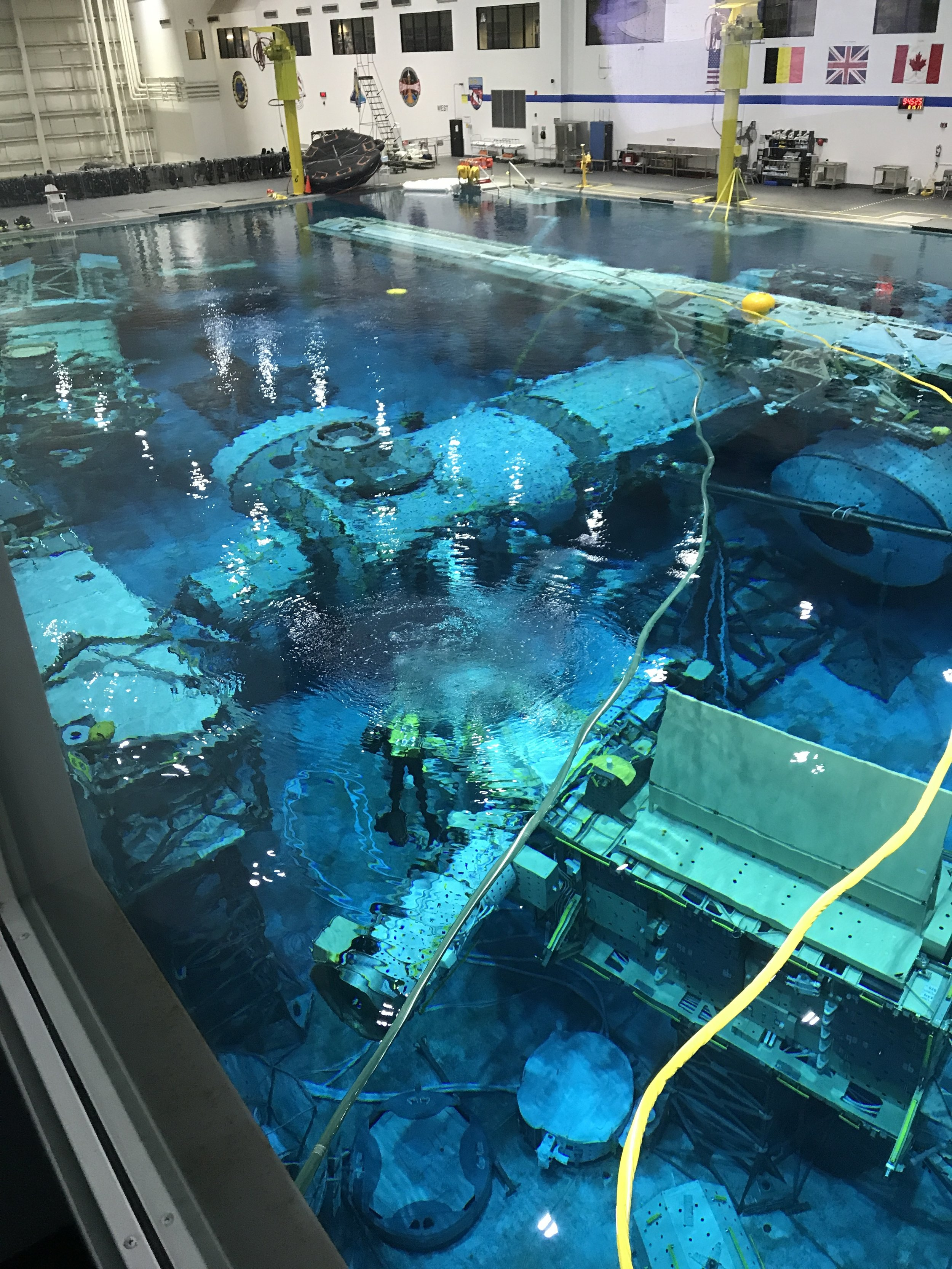 Divers are seen positioning equipment in the massive pool which is over 40 feet deep.