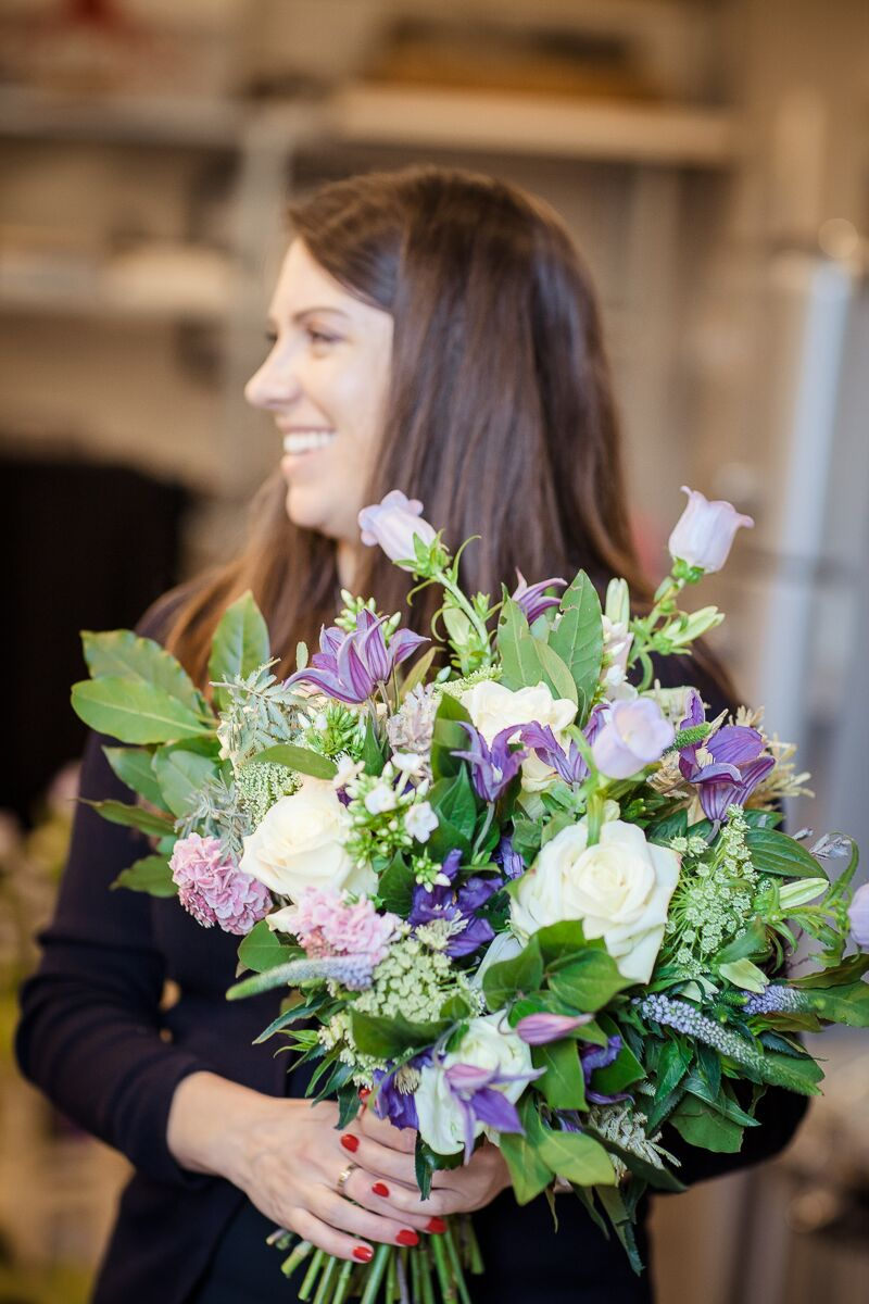 Charlotte in her happy place, creating bespoke arrangements