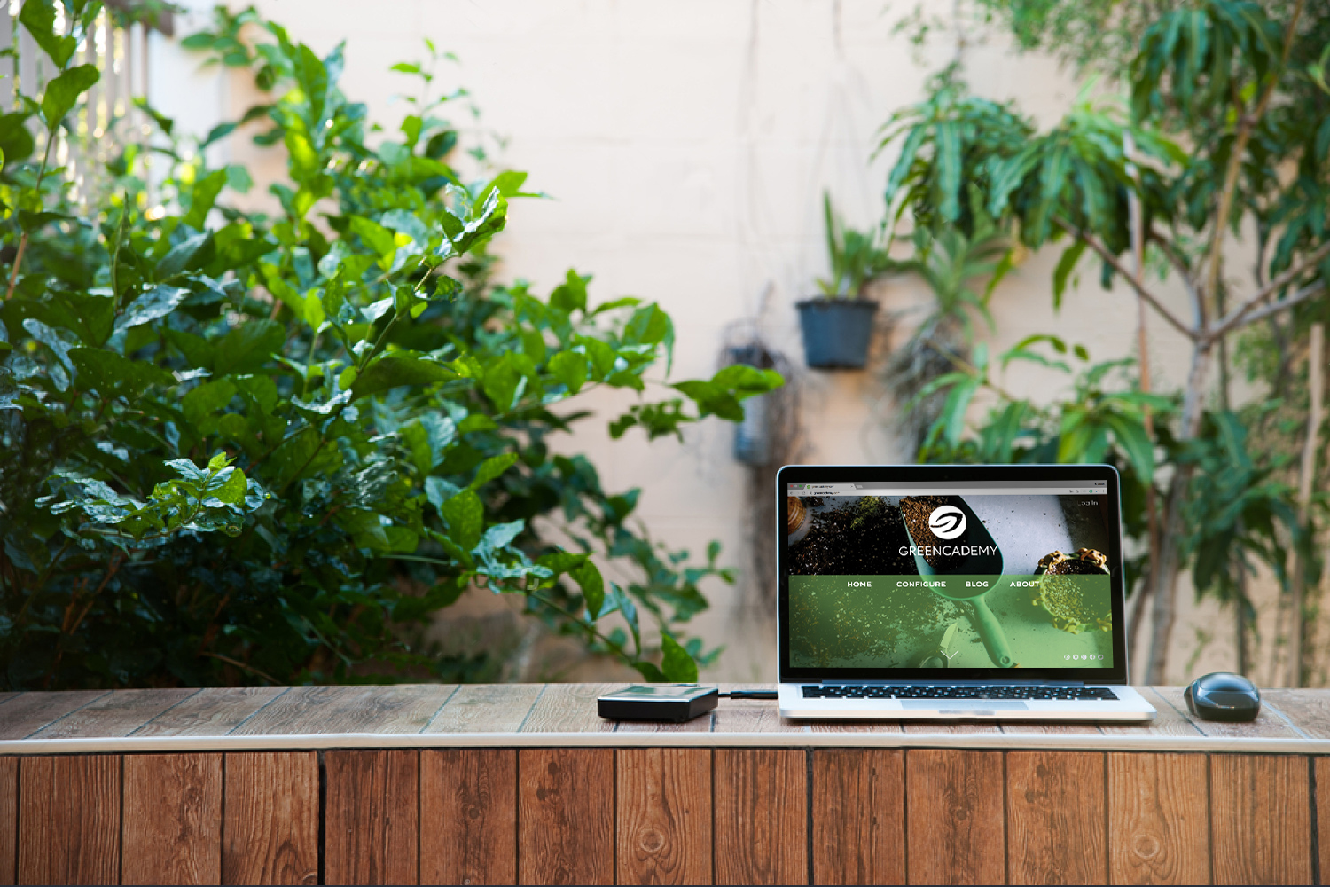 stock-photo-laptop-computer-mock-up-with-hard-disk-on-wood-texture-in-garden-right-of-frame-relax-from-work-361410482-2.jpg