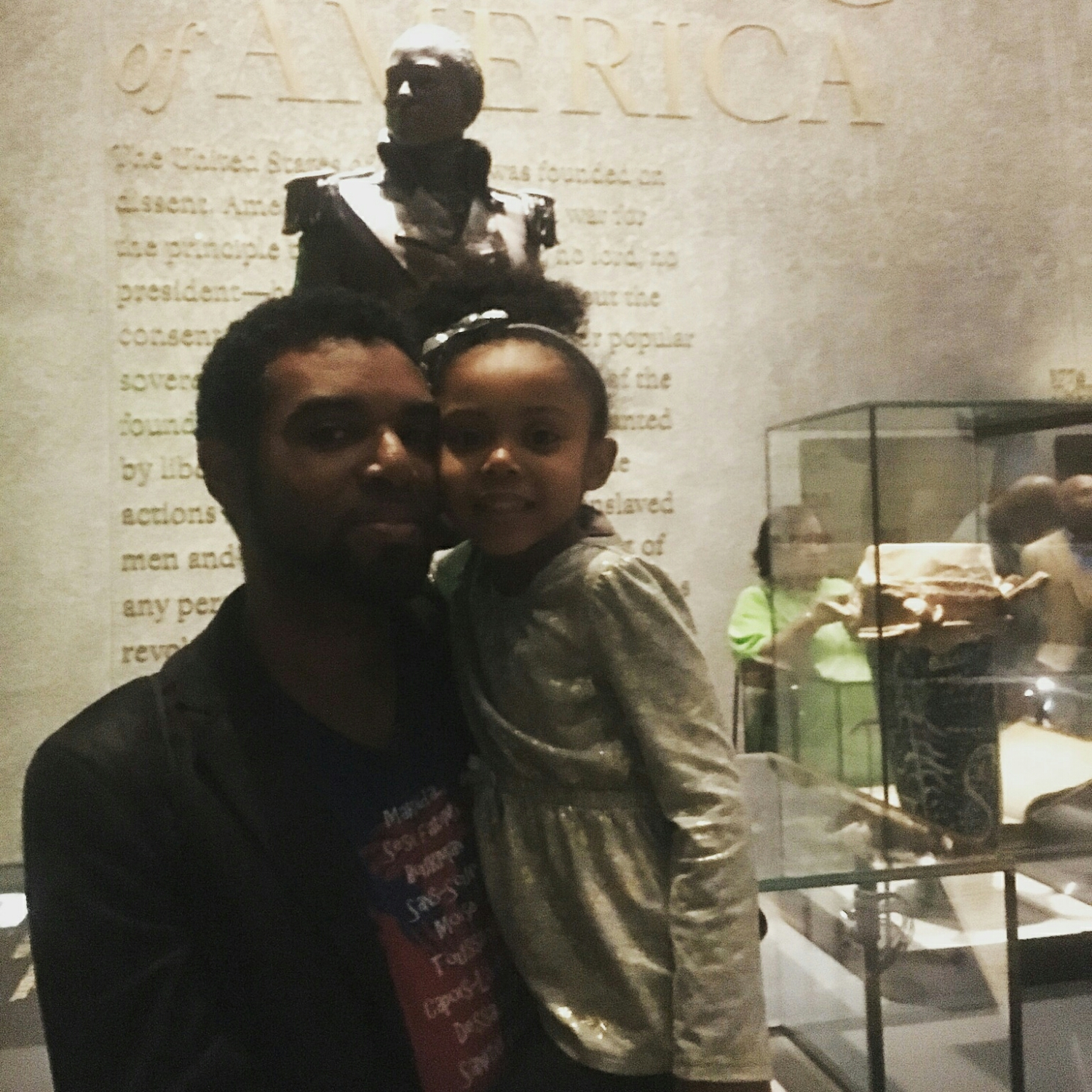 at the National Museum of African-American History and Culture (NMAAHC) with a statue of Toussaint L'Ouverture behind us