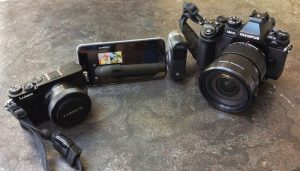 The Panasonic GM-5, iPhone 6 with DXO One attached, and my Olympus OM-D E-M1