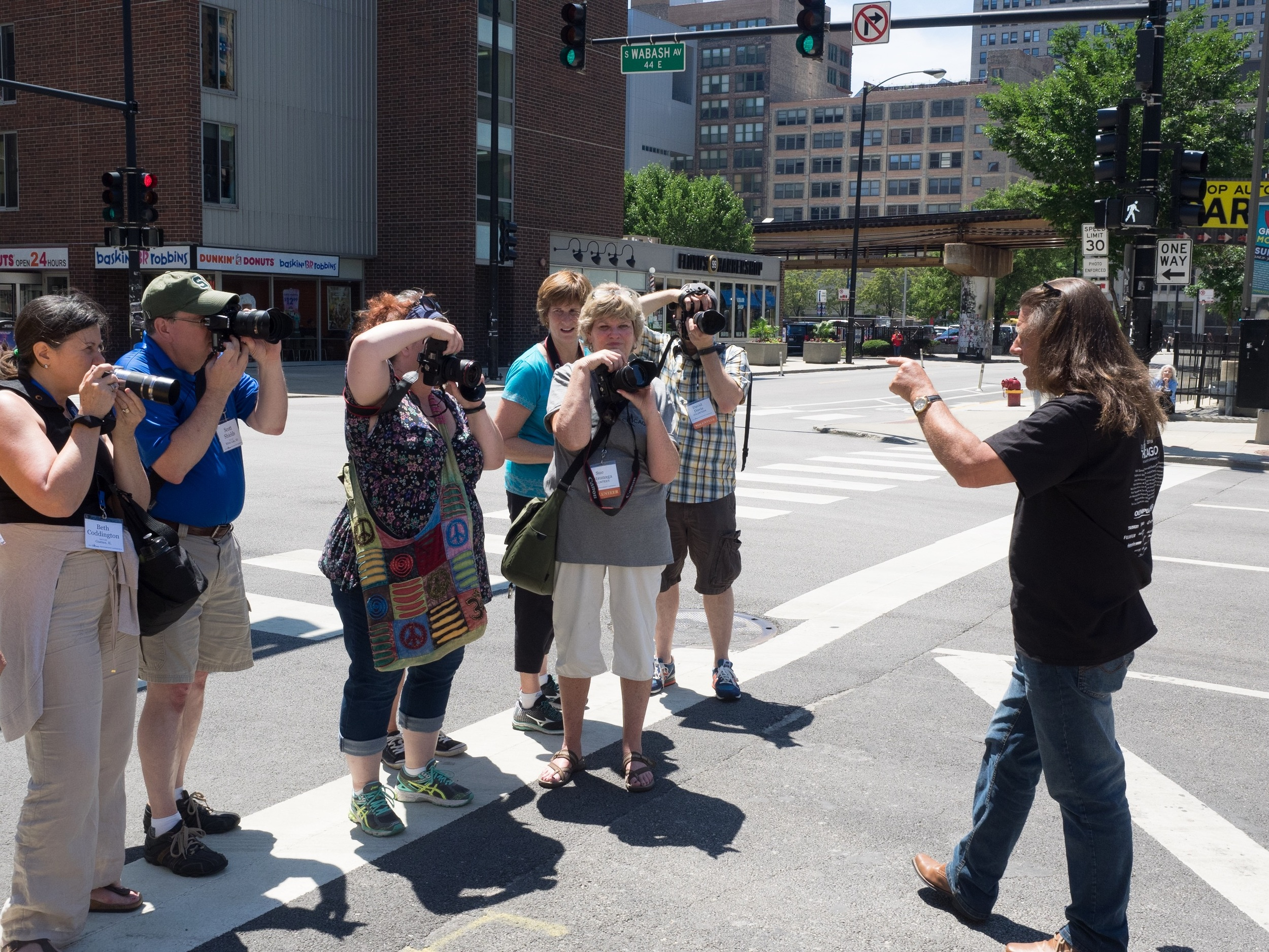 Bryan Peterson giving workshop participants directions for their next shooting assignment.