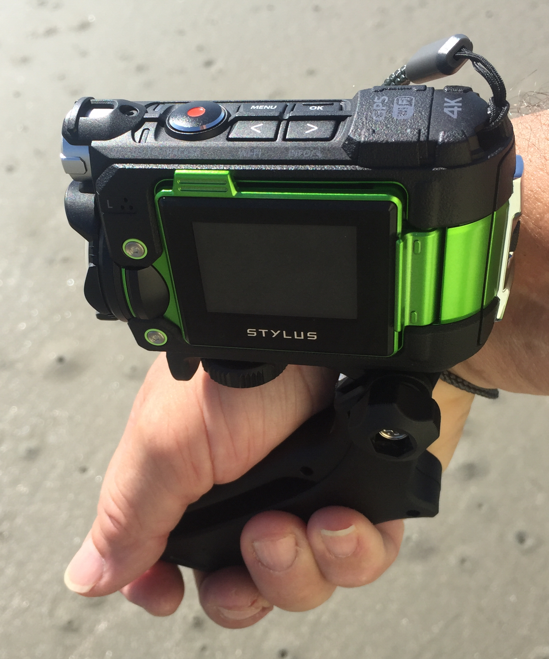 Putting grip on backwards allows you to hold the camera facing forward close to your side.