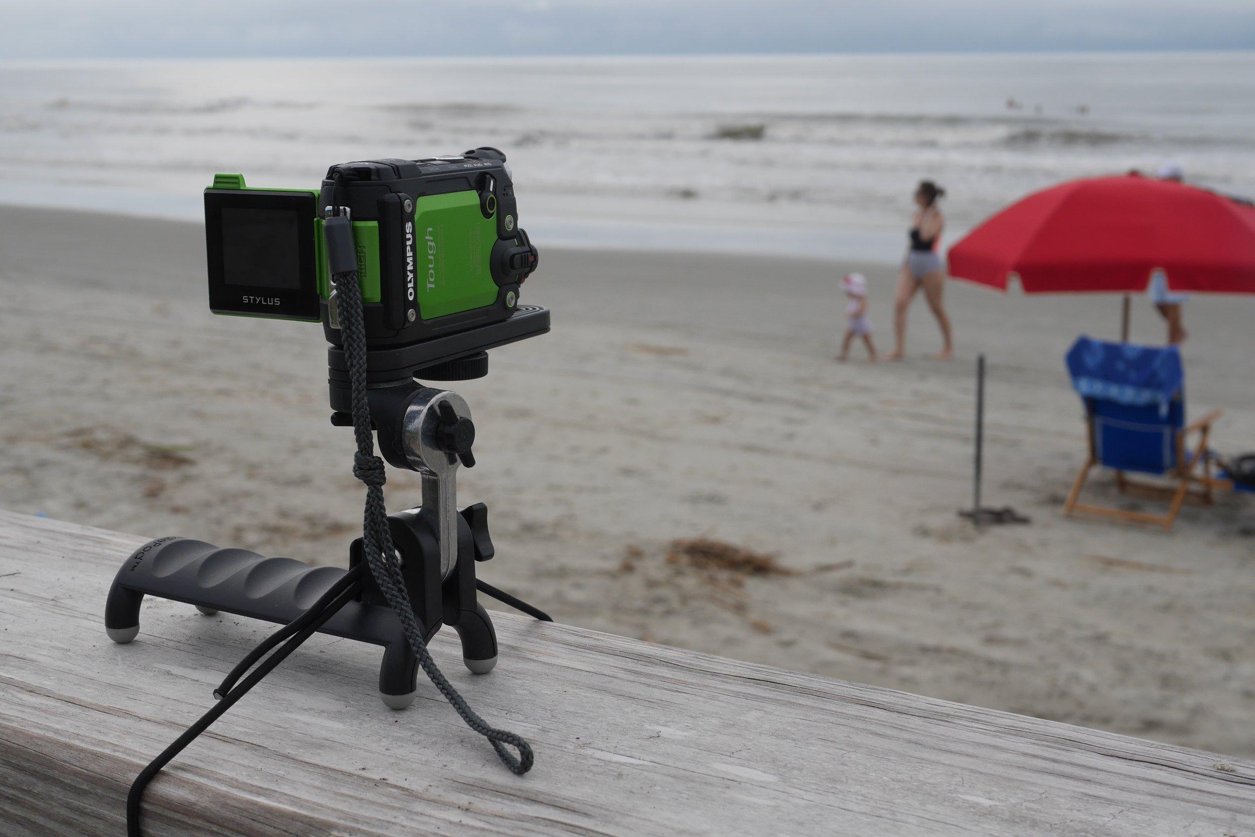 The HandlePod in action holding my Olympus Tough TG-Tracker on a beach boardwalk railing.