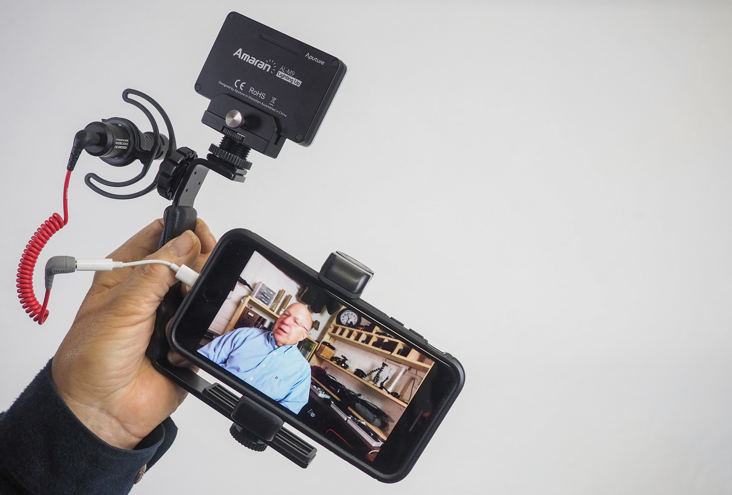 """A mobile video """"kit"""" complete with smartphone, microphone, and LED light."""